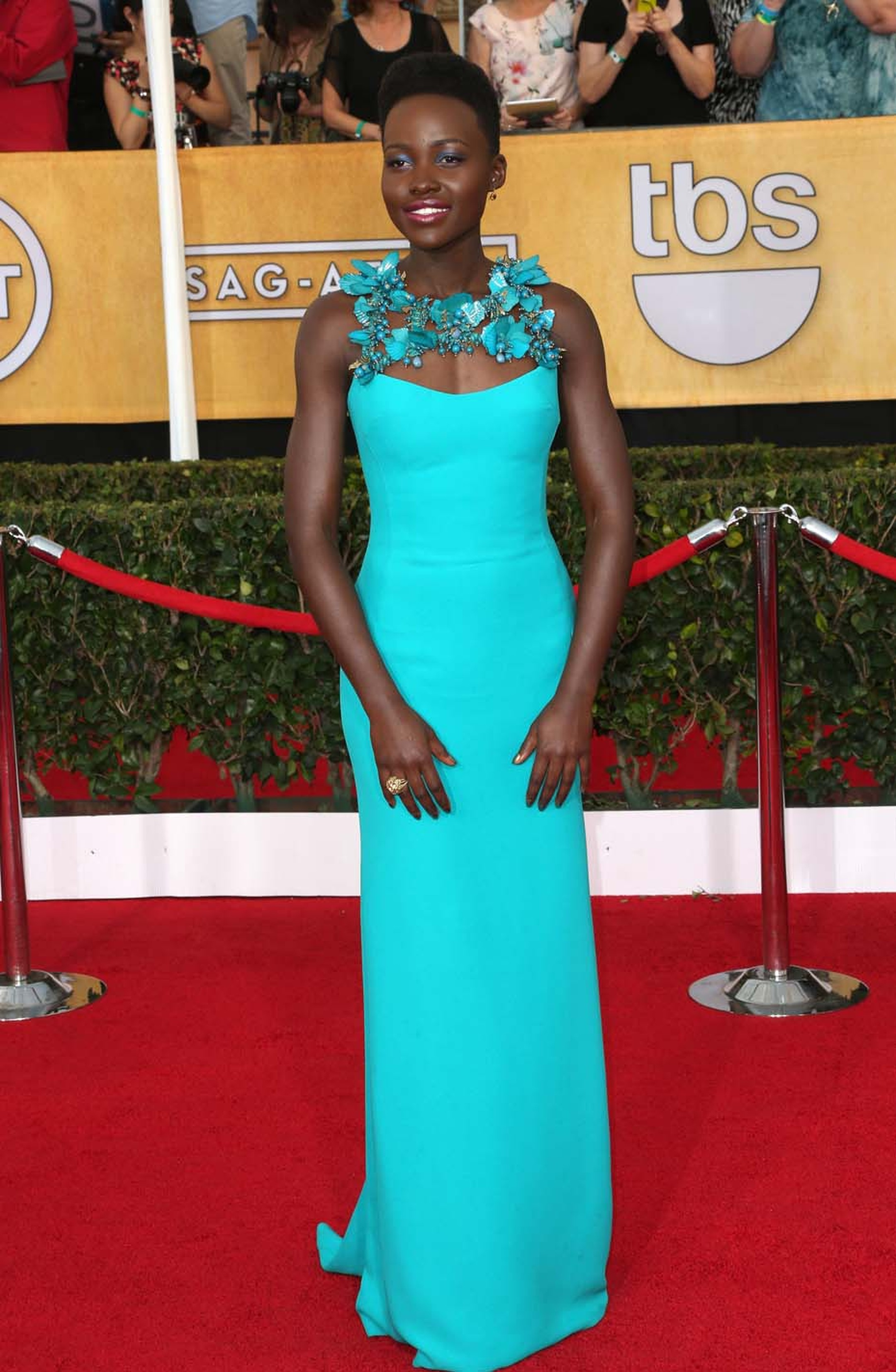 Lupita Nyong'o wore a statement 1950s gold flower ring with rubies, sapphires, emeralds and diamonds from Fred Leighton for the SAG Awards 2014