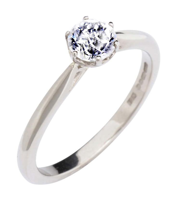 CRED's solitaire diamond engagement ring features a basket setting in Fairtrade gold.