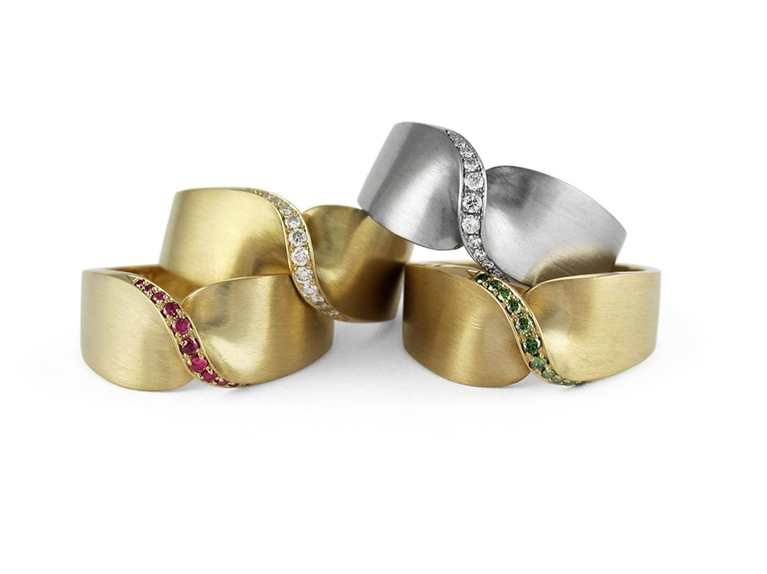 Wedding band designs from Jessica Poole in Fairtrade white and yellow gold, set with pavé diamond, rubies and emeralds.