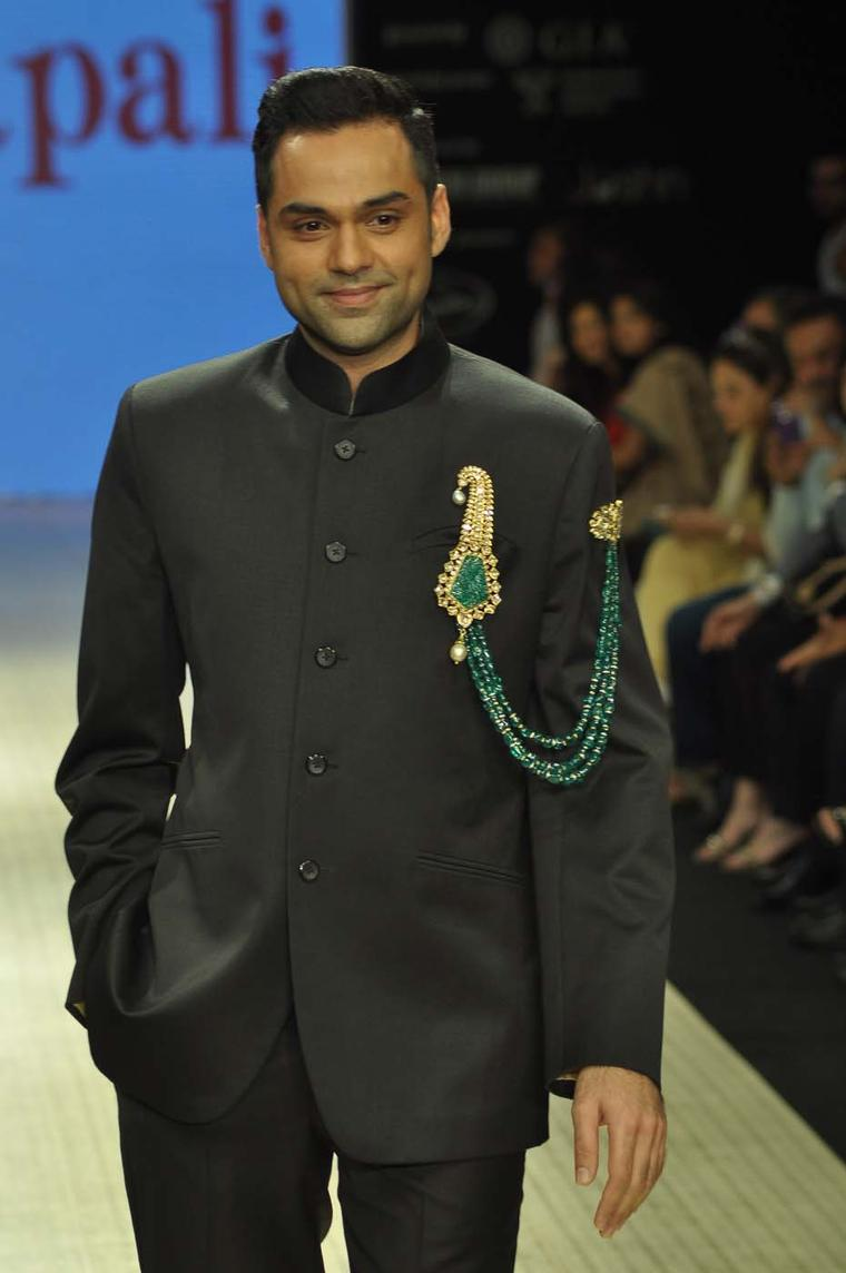 Actor Abhay Deol wearing an Amrapali emerald and kundan polki double pin brooch at Indian International Jewellery Week 2012.