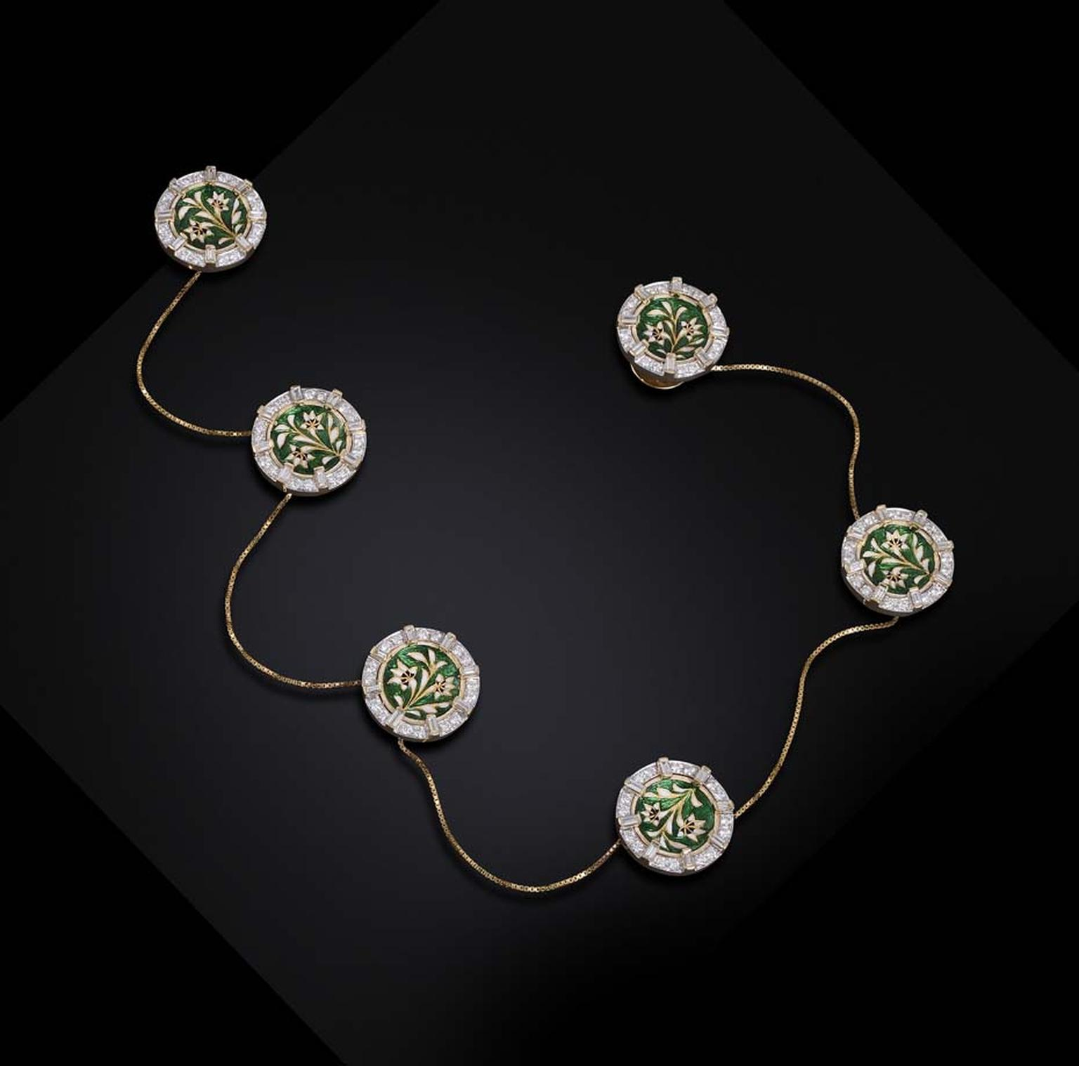 Farah Khan's diamond kurta buttons with rich green and white floral enamel are attached by gold chains.