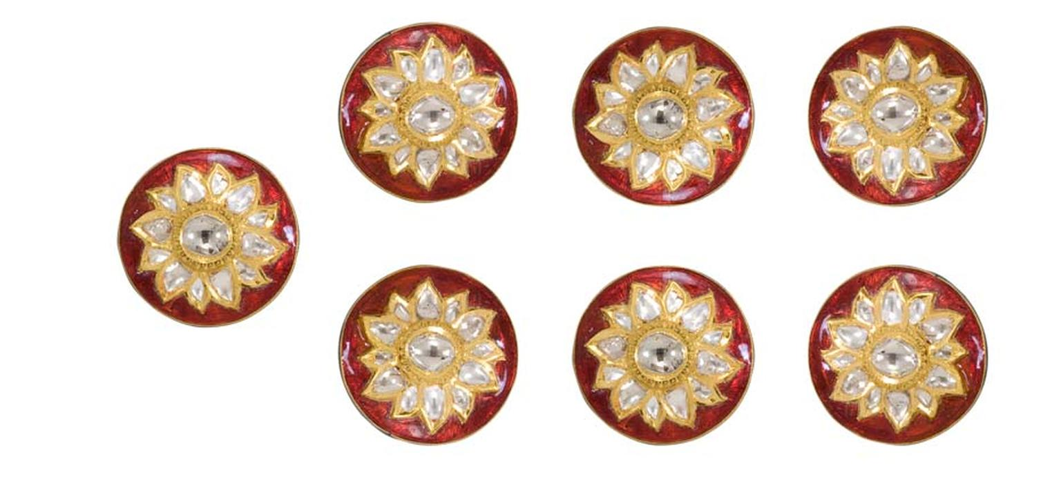 A set of seven Sunita Shekhawat sherwani buttons featuring kundan polki and red enamel.