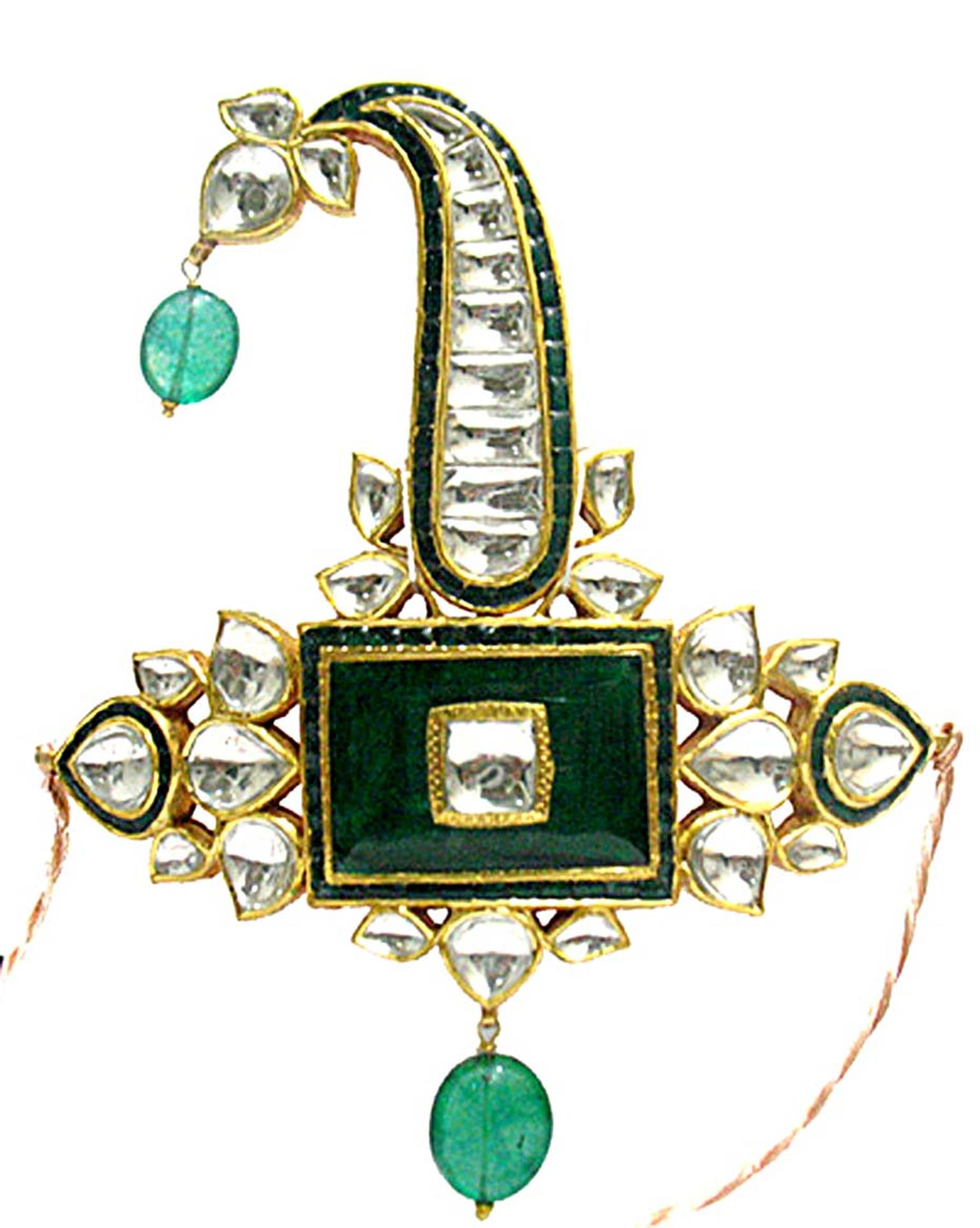 An emerald and uncut diamond sarpech by Sunita Shekhwat.