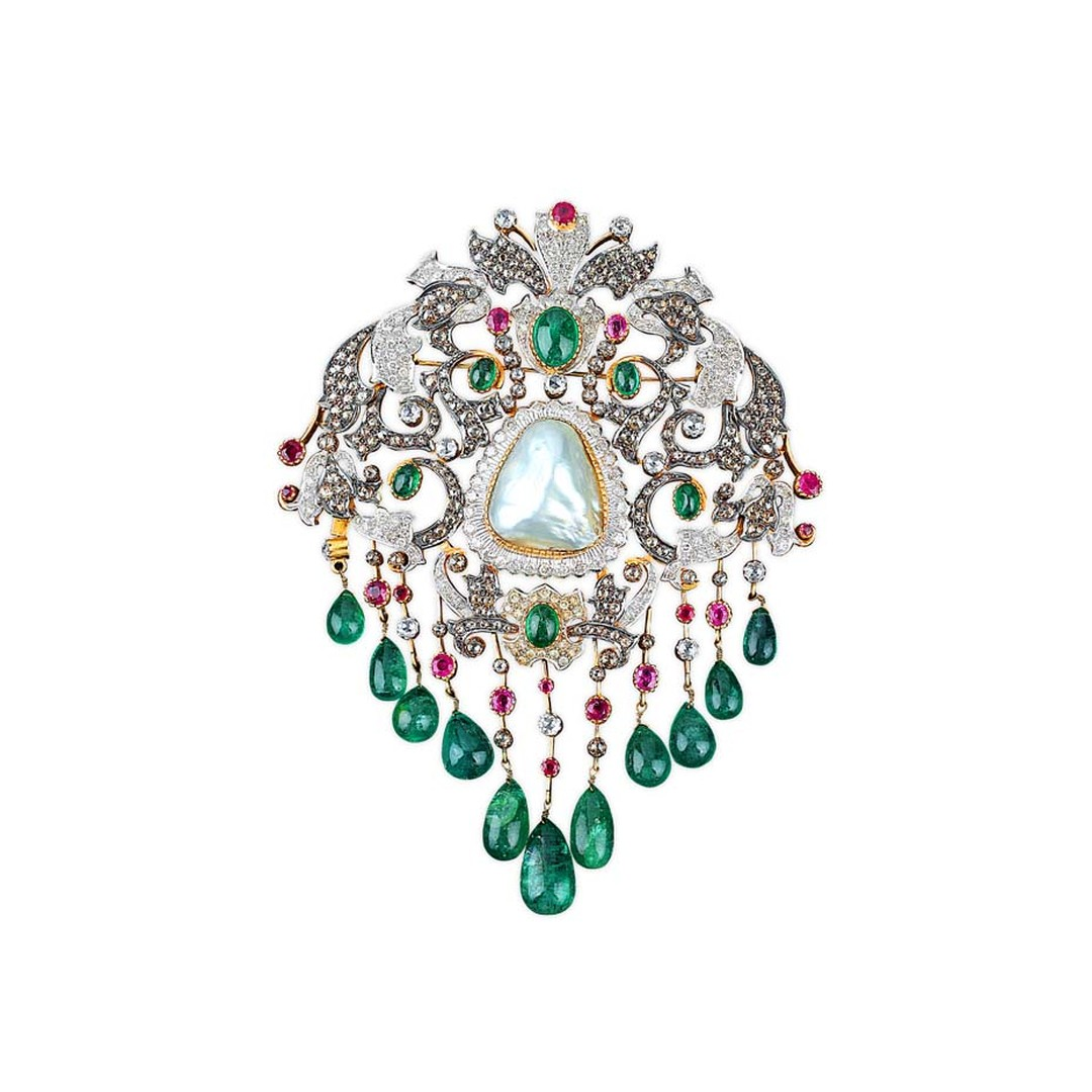 Golecha's vintage-inspired brooch featuring diamonds, rubies and emerald drops set with a large central pearl.