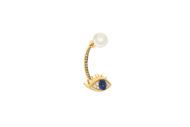 Delfina Delettrez Eye Piercing earring featuring gold, diamonds, light blue sapphires, a black diamond and a pearl. Available at Dover Street Market (£1,450).