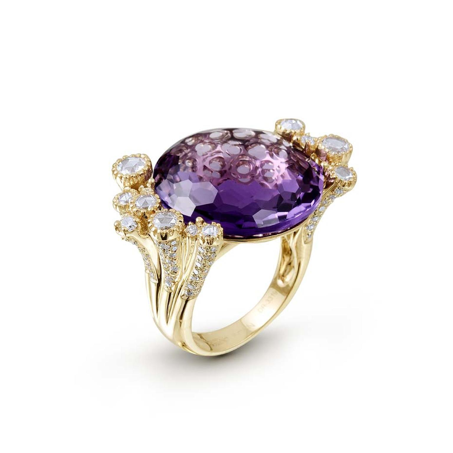 Farah Khan Crow ring with a central amethyst surrounded by diamonds, rubies and emeralds, set in rose gold