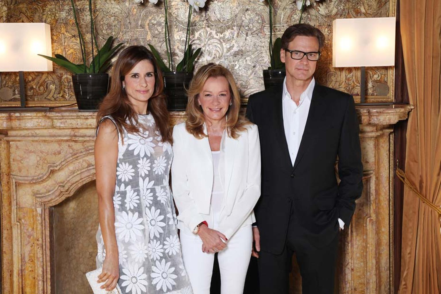 Livia Firth pictured with Caroline Scheufele and her husband, actor Colin Firth at the launch of the third piece in Chopard's Green Carpet Collection at the Venice Film Festival