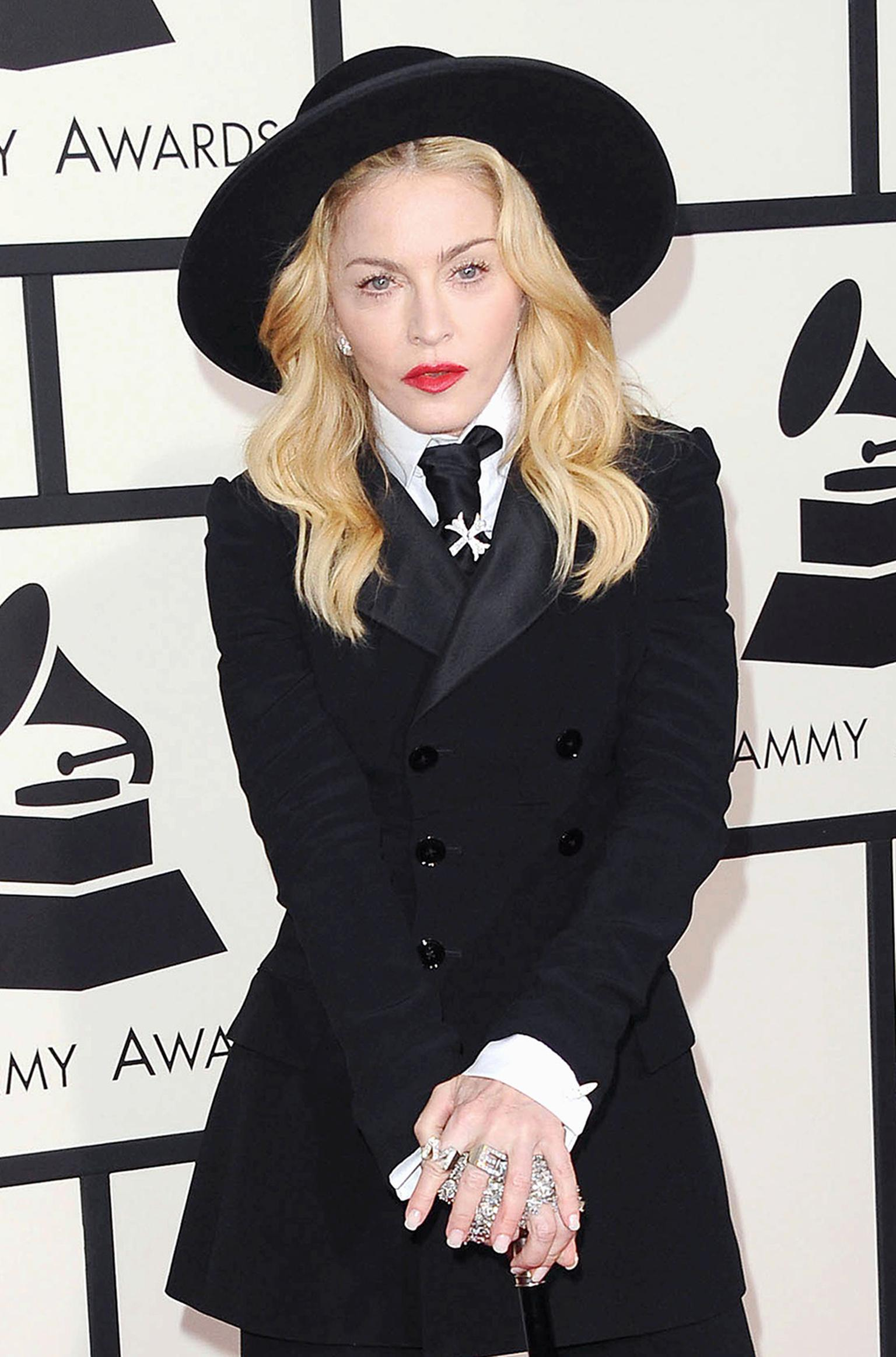 "Madonna caused a stir at the Grammy Awards 2014 wearing diamond initial ""M"" and ""E"" rings by Neil Lane"