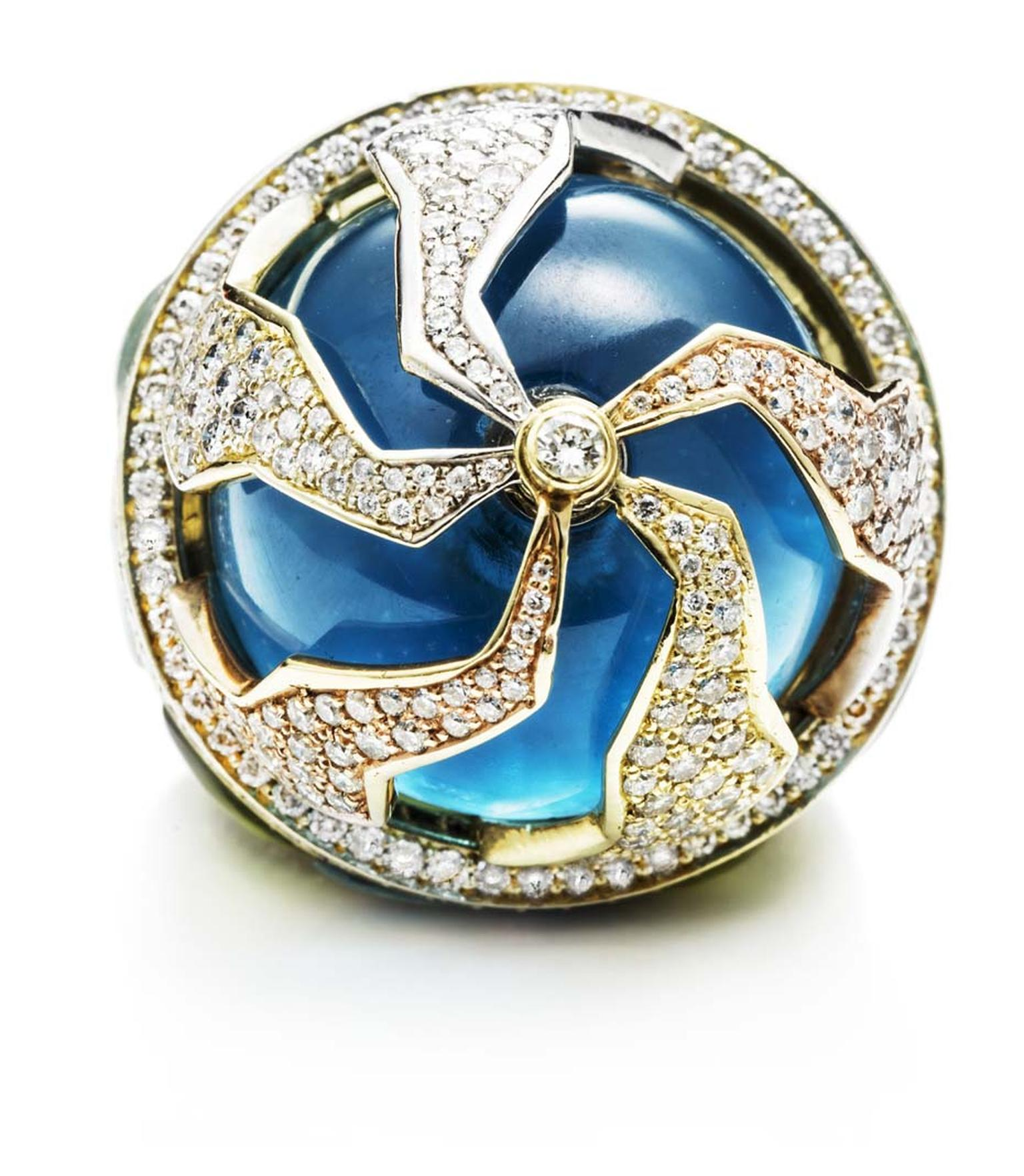 Kara Ross' Pangea ring has five moveable pieces that move independently above the blue topaz cabochon