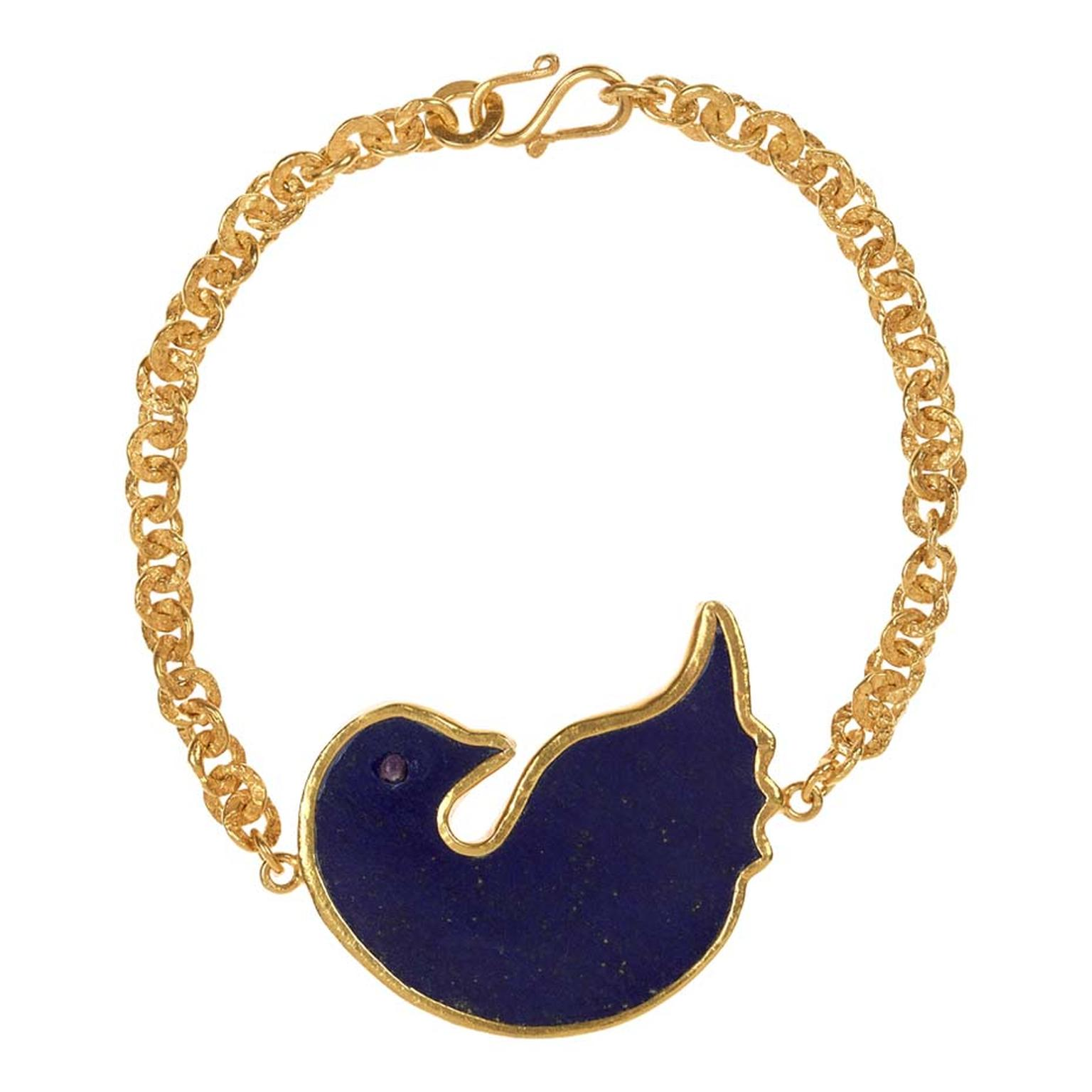 Pippa Small's gold Turquoise Mountain bracelet includes a dove of peace in lapis lazuli.