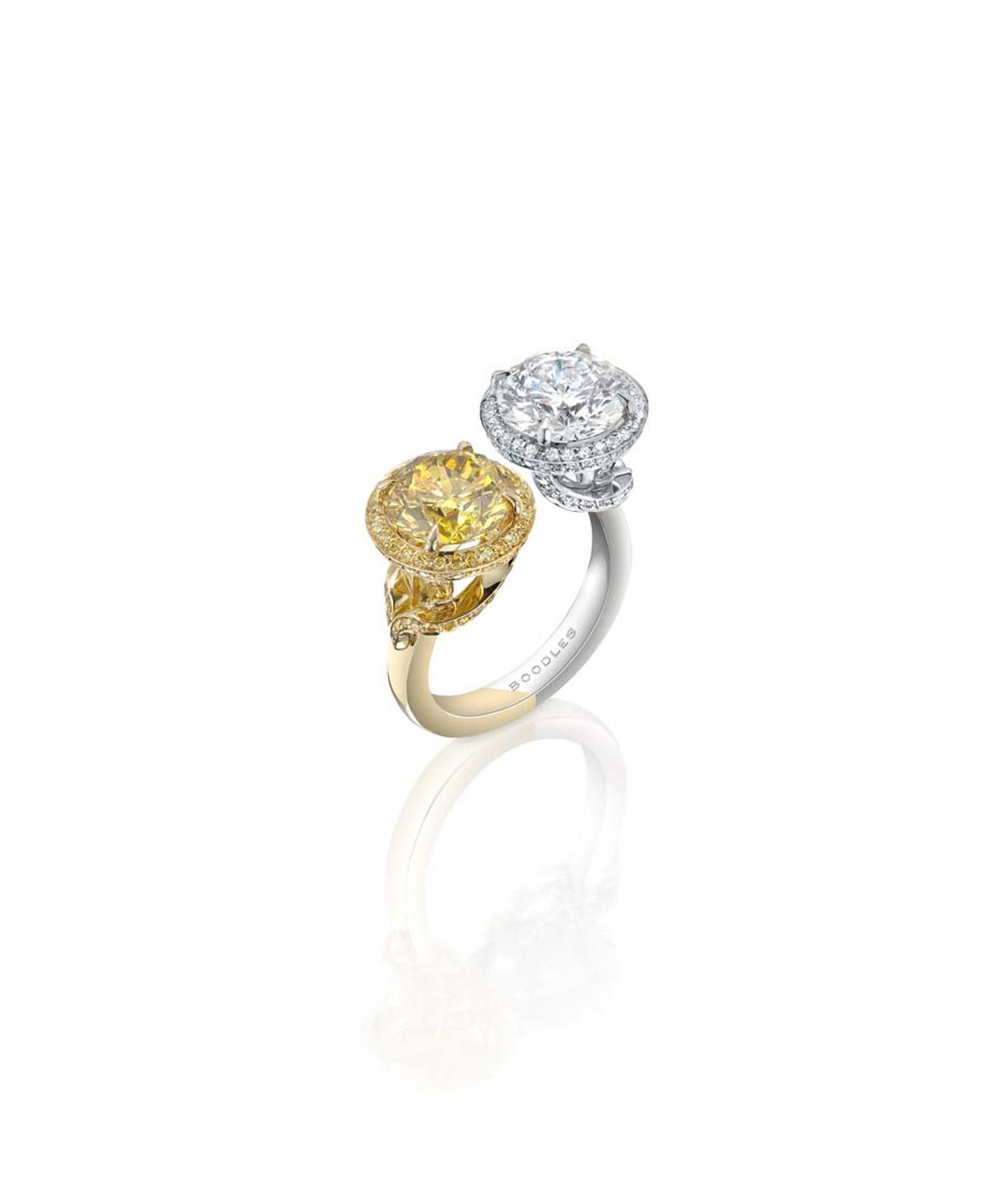 Boodles Gemini yellow and white gold ring set with a 3ct natural Fancy Vivid yellow diamond alongside a 3ct white diamond