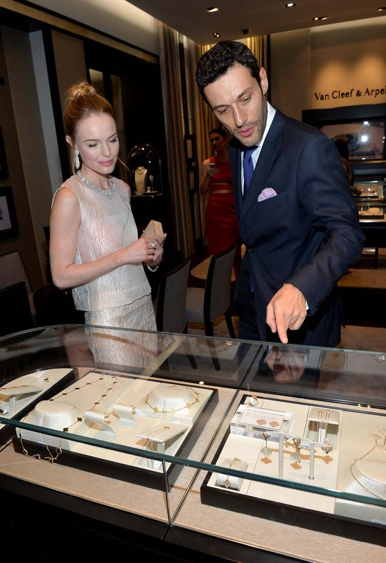 Kate Bosworth peruses some of the jewels on display alongside Alain Bernard, president and CEO of Van Cleef & Arpels, The Americas