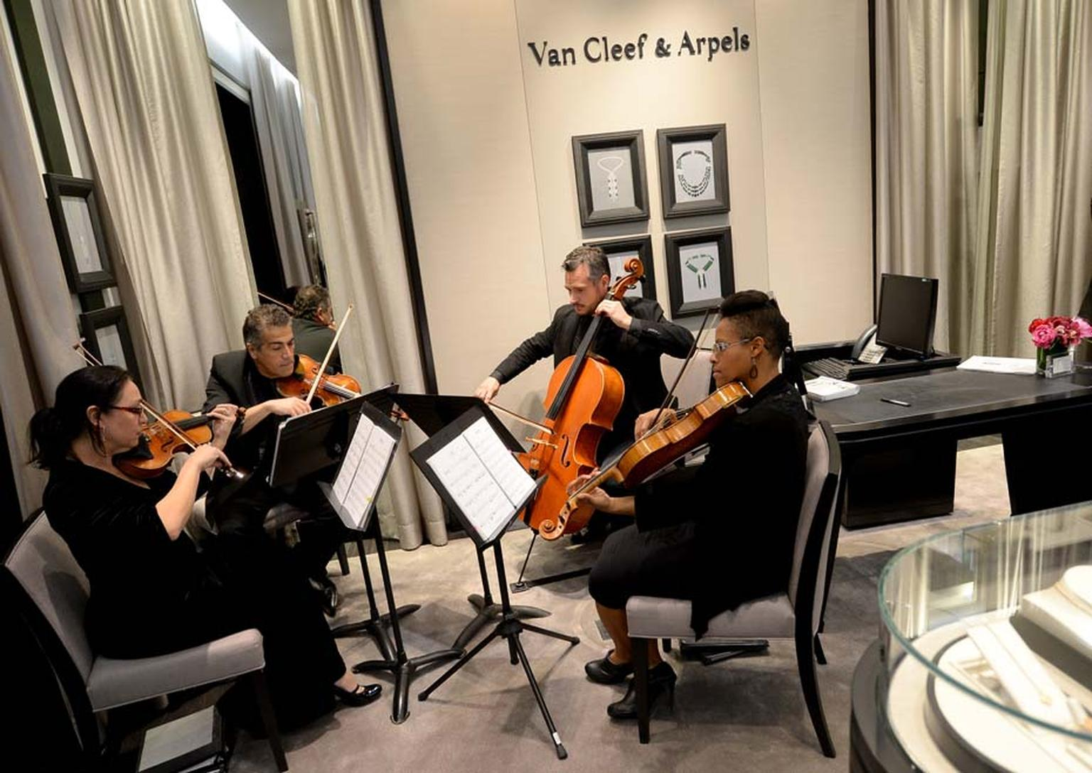 VIP guests enjoyed champagne and a string quartet performance