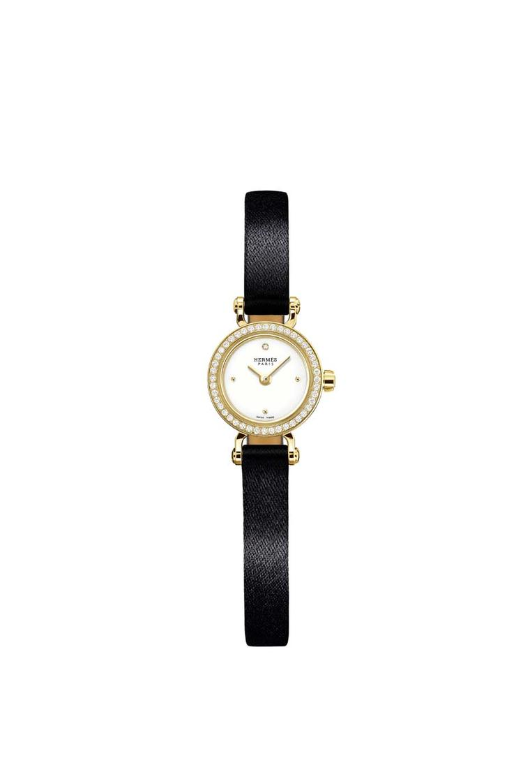 Hermès Faubourg watch with a yellow gold case and black satin strap