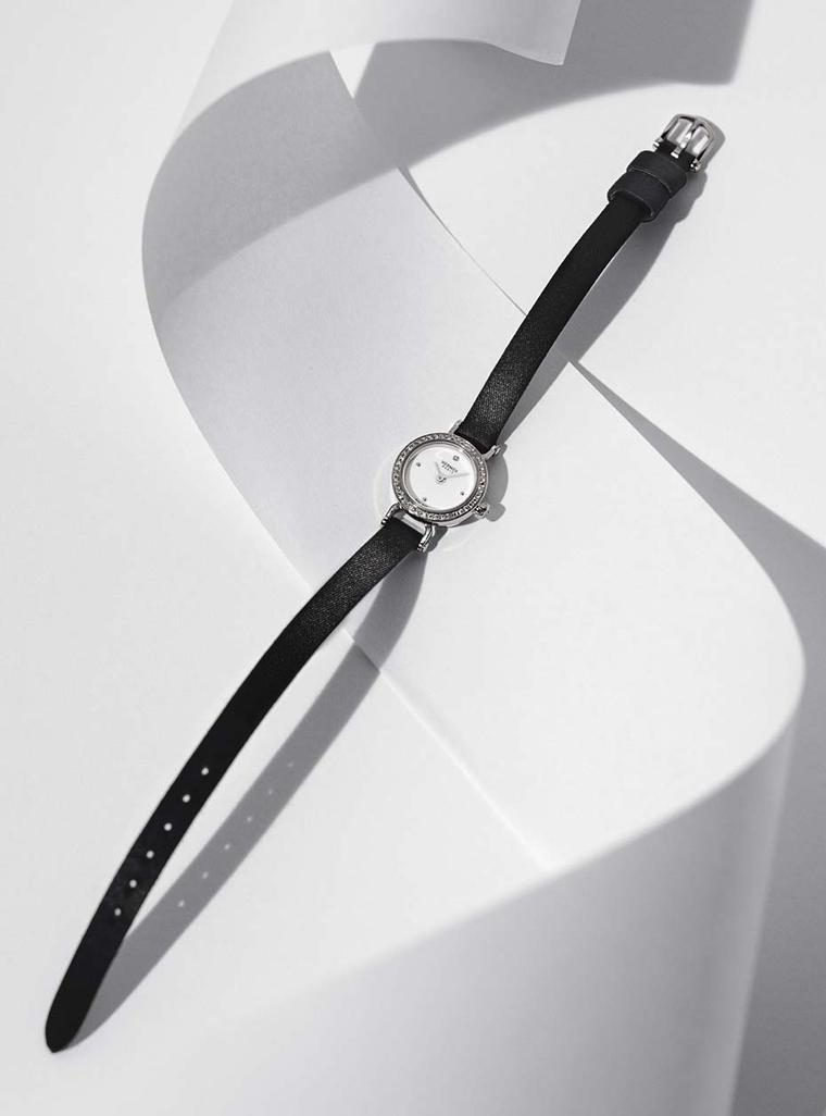 Hermès Faubourg watch featuring a diamond-set white gold case and black satin strap