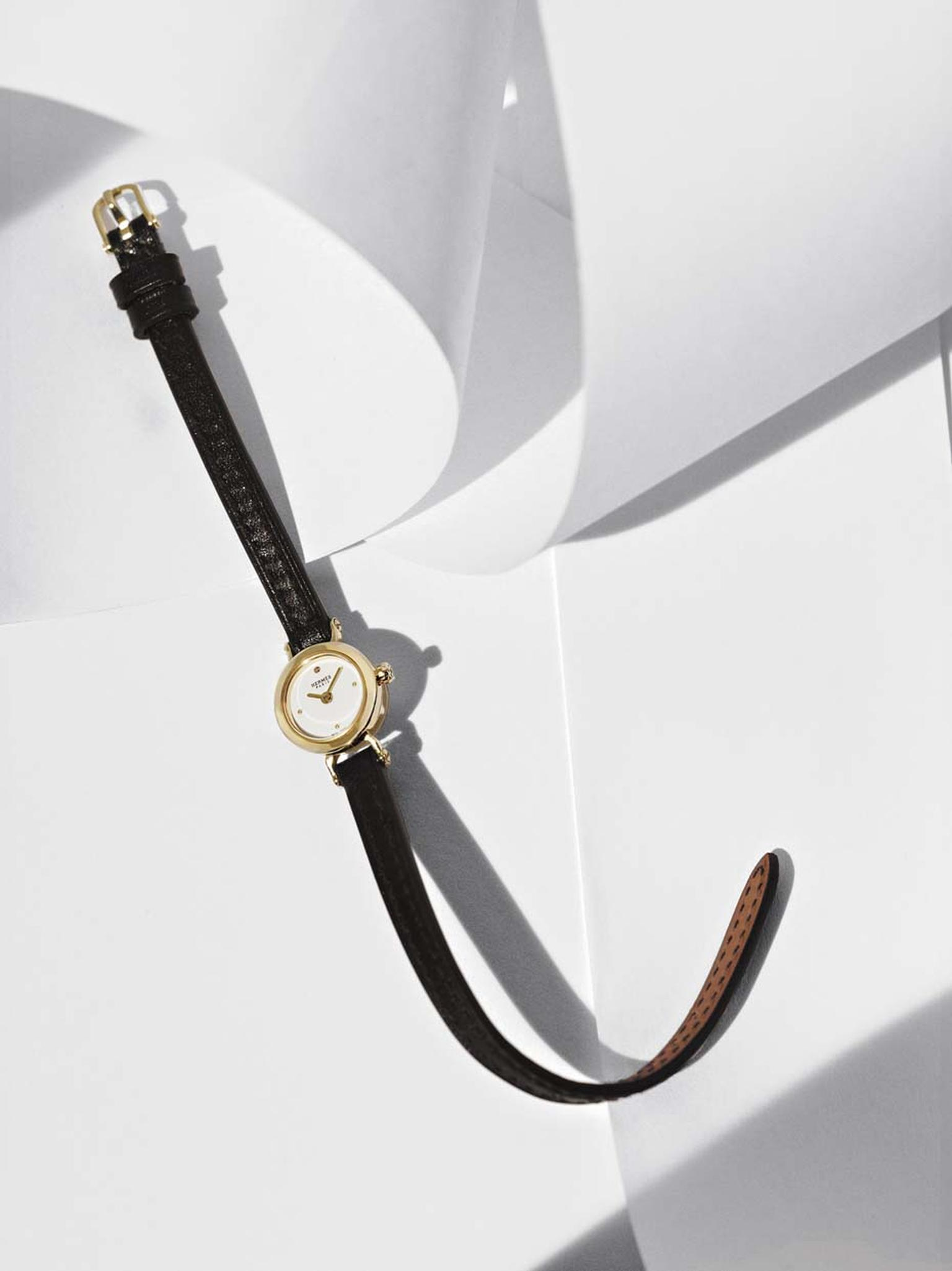 Hermès Faubourg watch with a yellow gold case and black Box calf strap