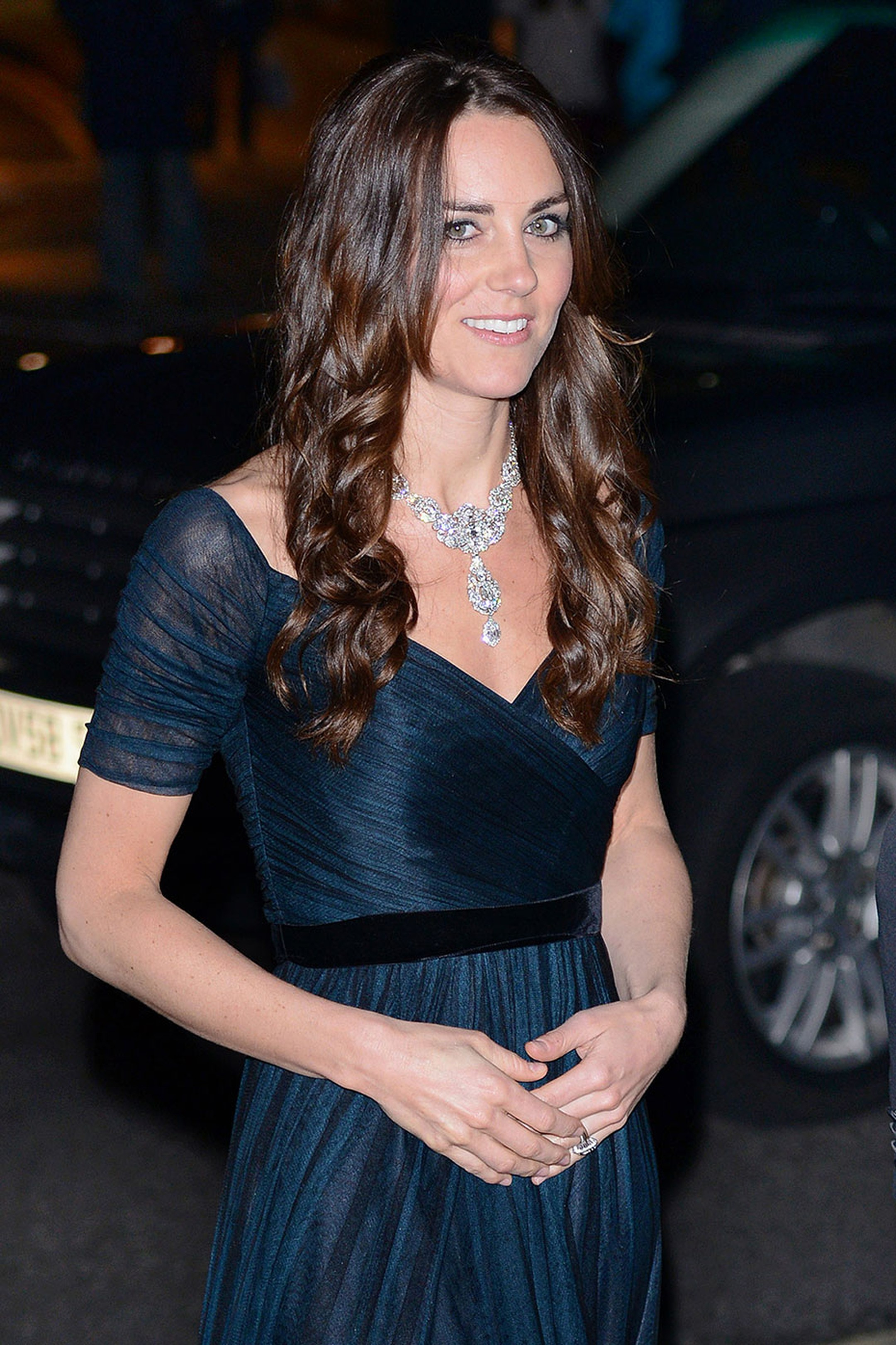 For her first royal engagement of 2014, Kate Middleton teamed a dark blue gown with an incredible diamond necklace by Cartier, loaned to her by the Queen