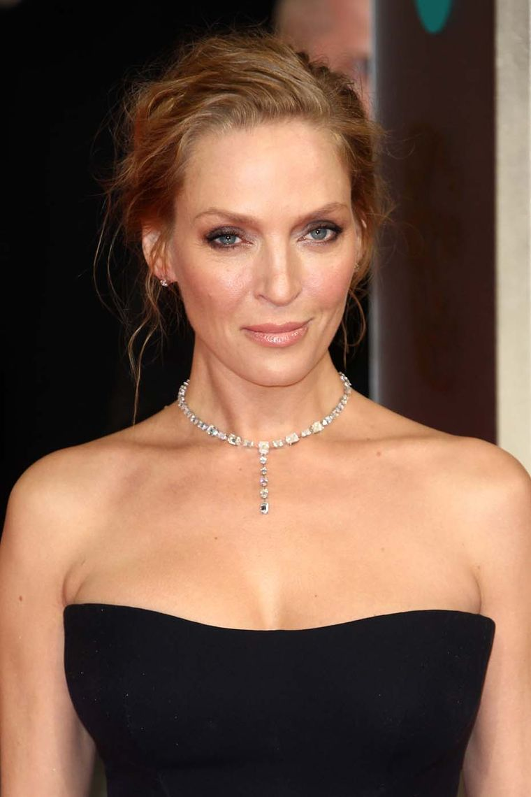 BAFTAs 2014 presenter Uma Thurman wore a necklace by Chopard featuring 32ct of diamonds, diamond stud earrings, a heart-shaped diamond bracelet and a ring from the Chopard Temptations collection