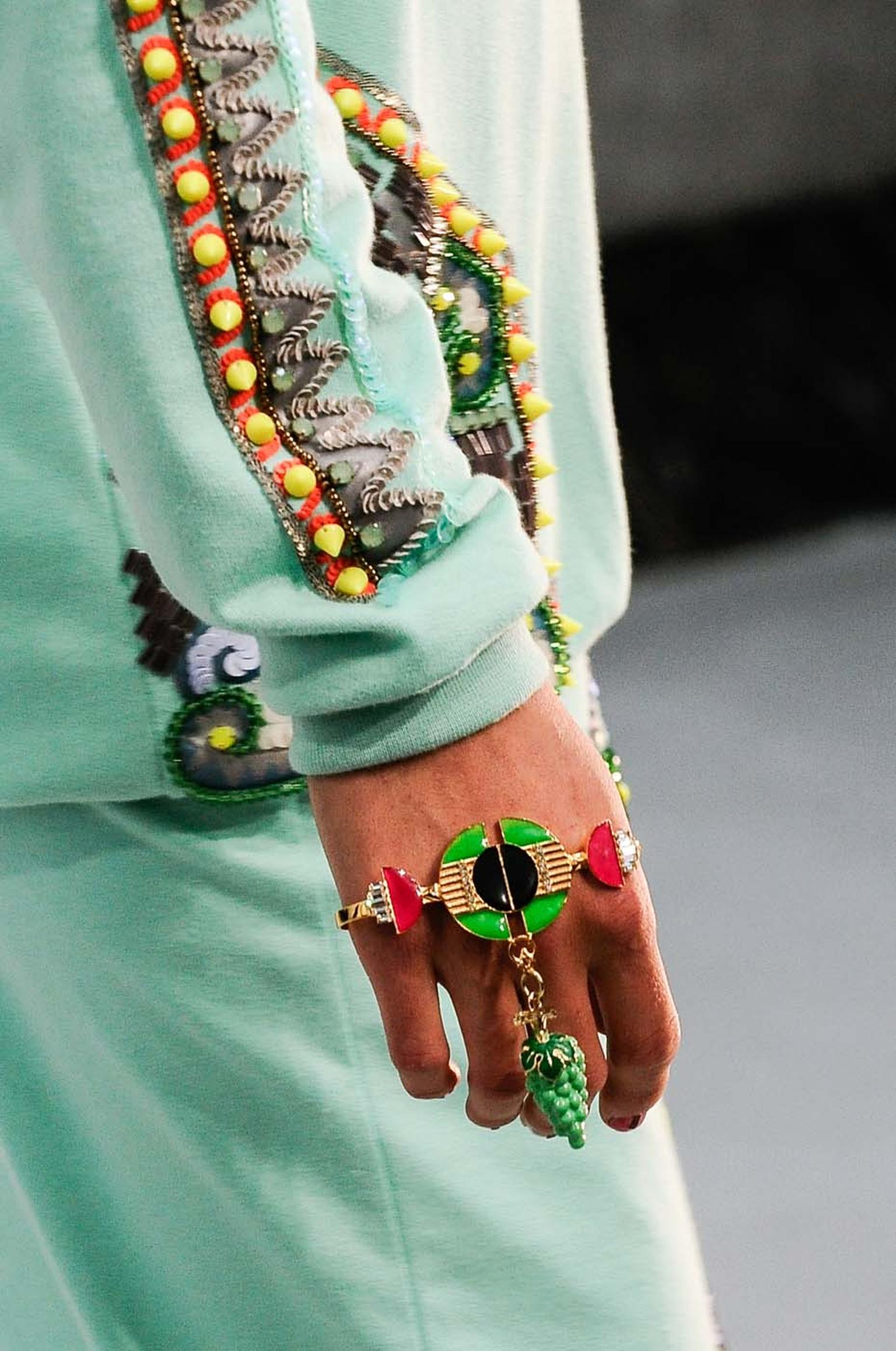 Incorporating structured shapes and prints, Amrapali for Manish Arora's jewels for 2014 continue the colourful theme of previous collection