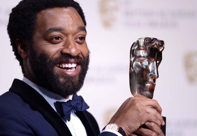 Chiwetel Ejiofor wearing a Jaeger-LeCoultre Master Ultra Thin Réserve de Marche watch.