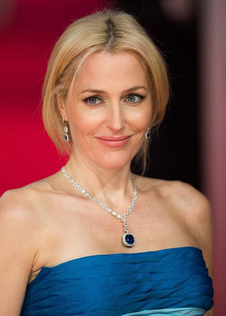 BAFTAs presenter Gillian Anderson showed a more demure look in matching sapphire earrings and necklace by Adler.