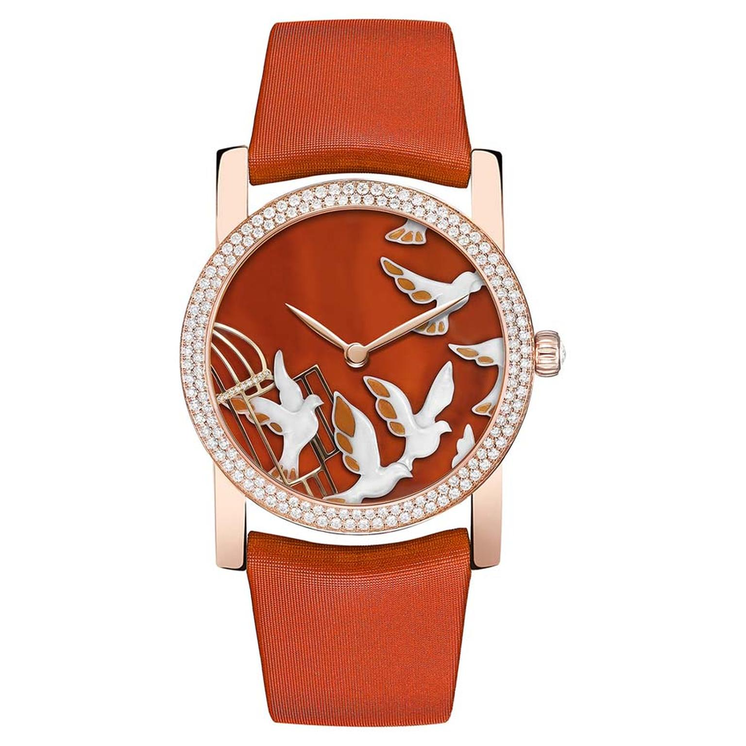 Chaumet's Attrape-moi…si tu m'aimes collection watch dial displays a group of doves sculpted from white agate
