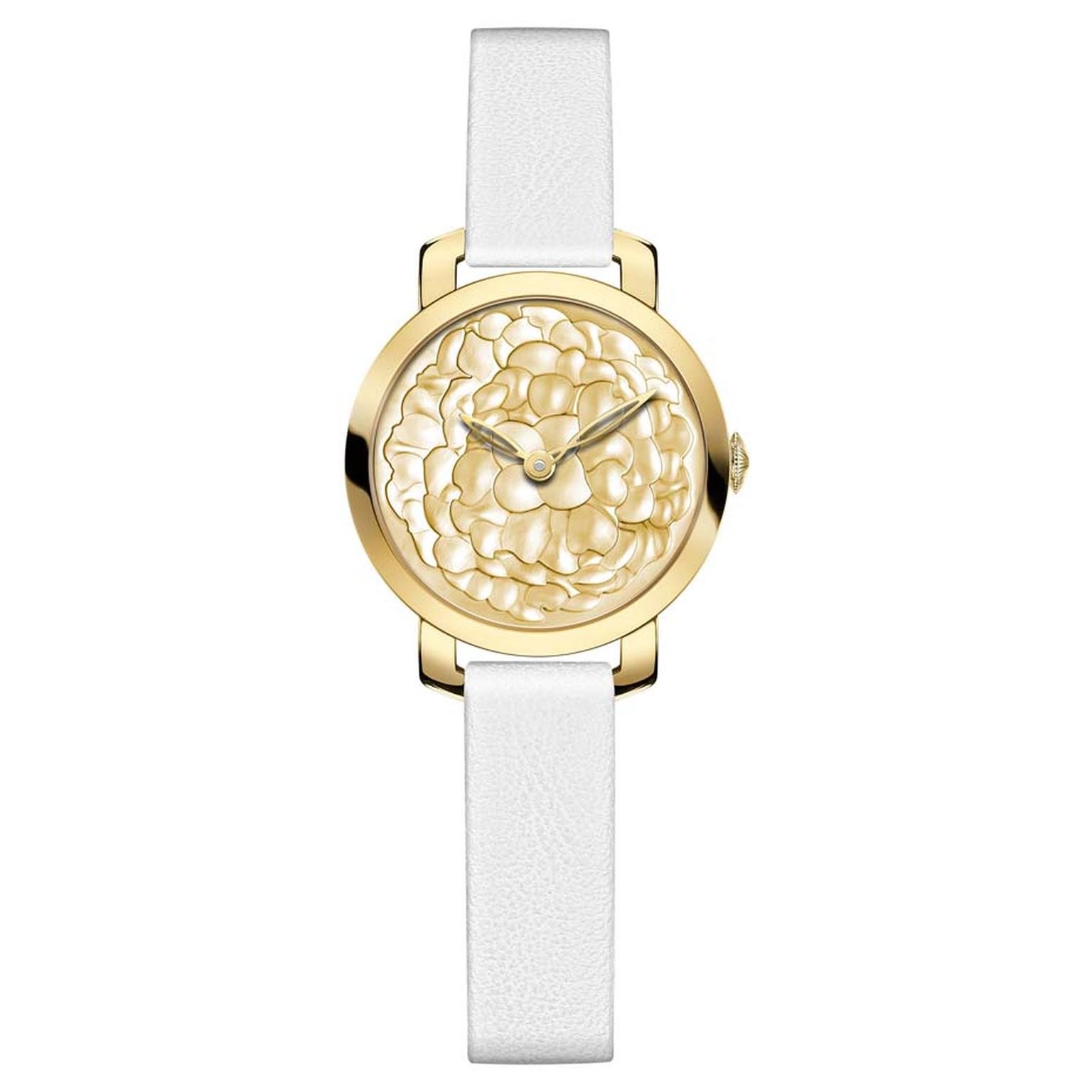 Chaumet Montres Pre´ciuses collection watch in yellow gold featuring a dial with rounded marquetry and polished gold mother of pearl