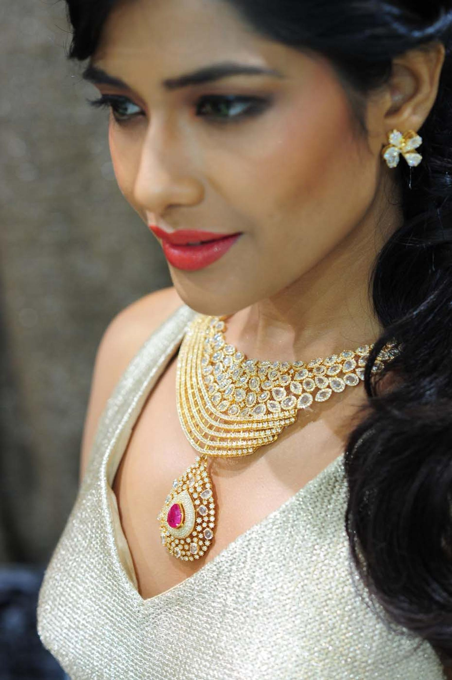 Varuna D Jani yellow gold necklace featuring diamonds and a central ruby
