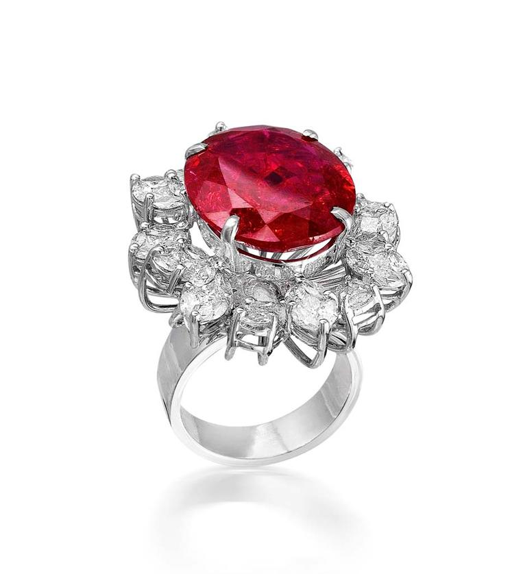 Varuna D Jani cocktail ring with diamonds surrounding a brilliant-cut ruby