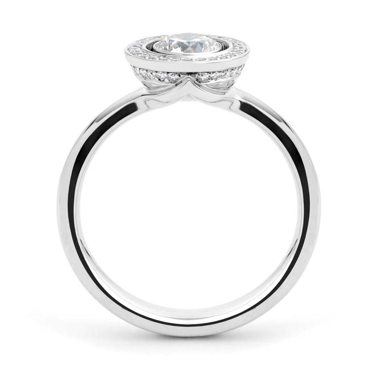 Andrew Geoghegan Lacuna white gold engagement ring featuring brilliant-cut diamond surrounding  a centre stone.
