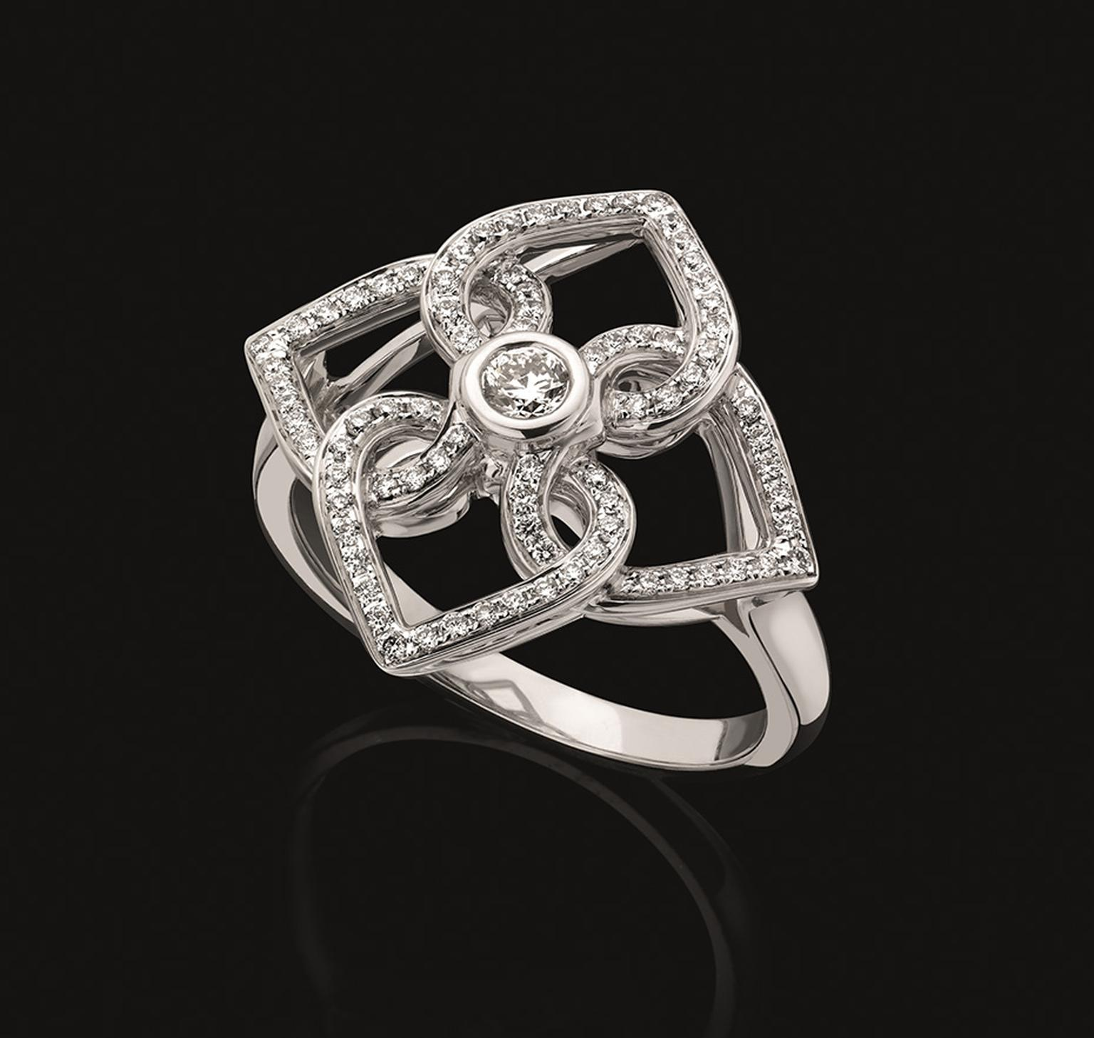 Backes & Strauss Four Heart ring featuring interlocking hearts set with 429 ideal cut round brilliant diamonds