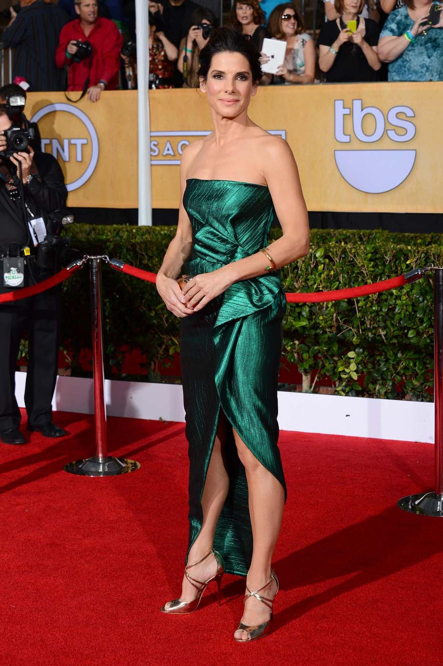 Sandra Bullock at the Screen Actors Guild Awards in January 2014 wearing an emerald-green Lanvin dress and Fred Leighton jewellery