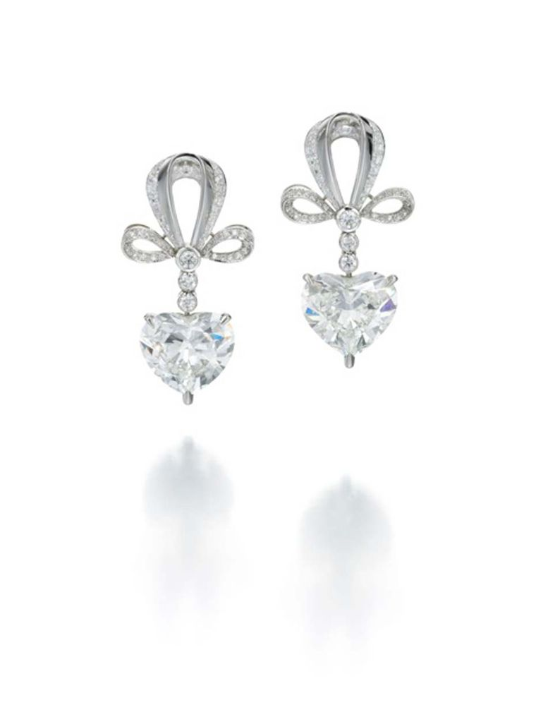 Jessica McCormack Heart Drop earrings in platinum featuring three brilliant-cut diamonds leading to a 4ct heart-shaped diamond