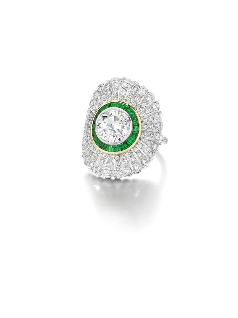 Jessica McCormack yellow and white gold Emerald Daisy ring set with a 1.80ct brilliant-cut diamond surrounded by hand-cut calibrated emeralds