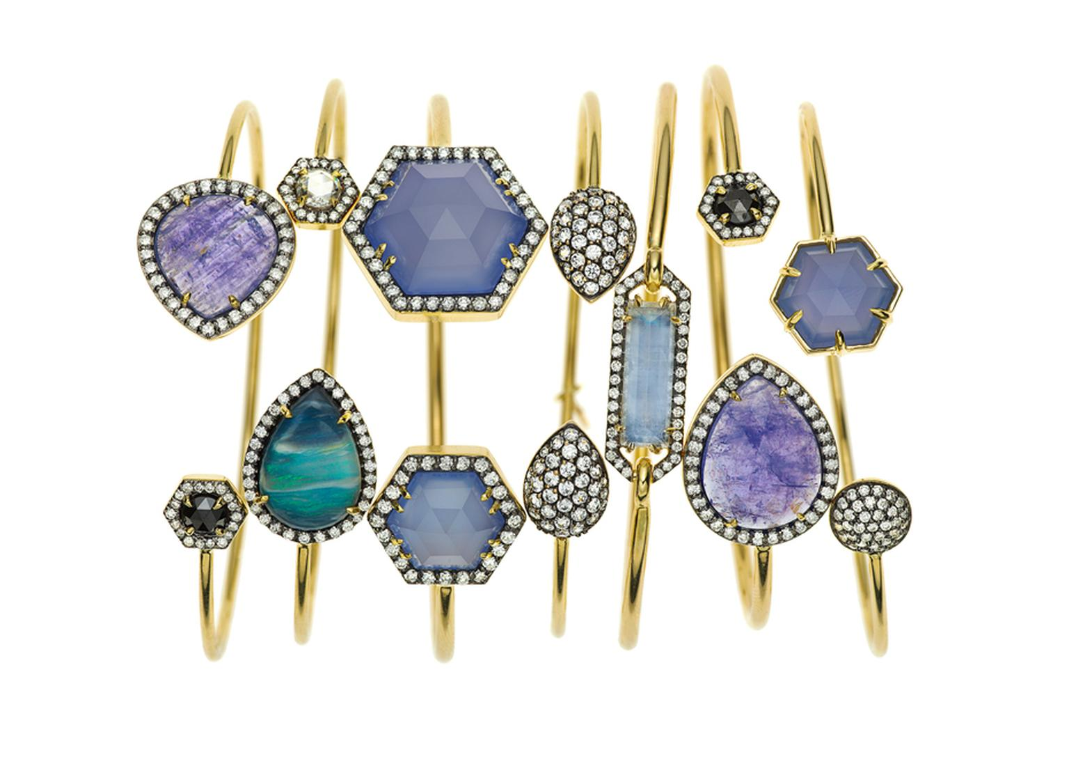 Jemma Wynne yellow gold bangles with tanzanite, boulder opal, blue chalcedony, rainbow moonstone and rose-cut black diamonds