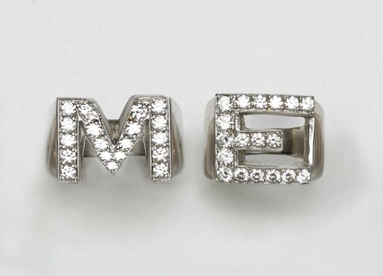 "The diamond initial ""M"" and ""E"" rings worn by Madonna at the Grammy Awards 2014"
