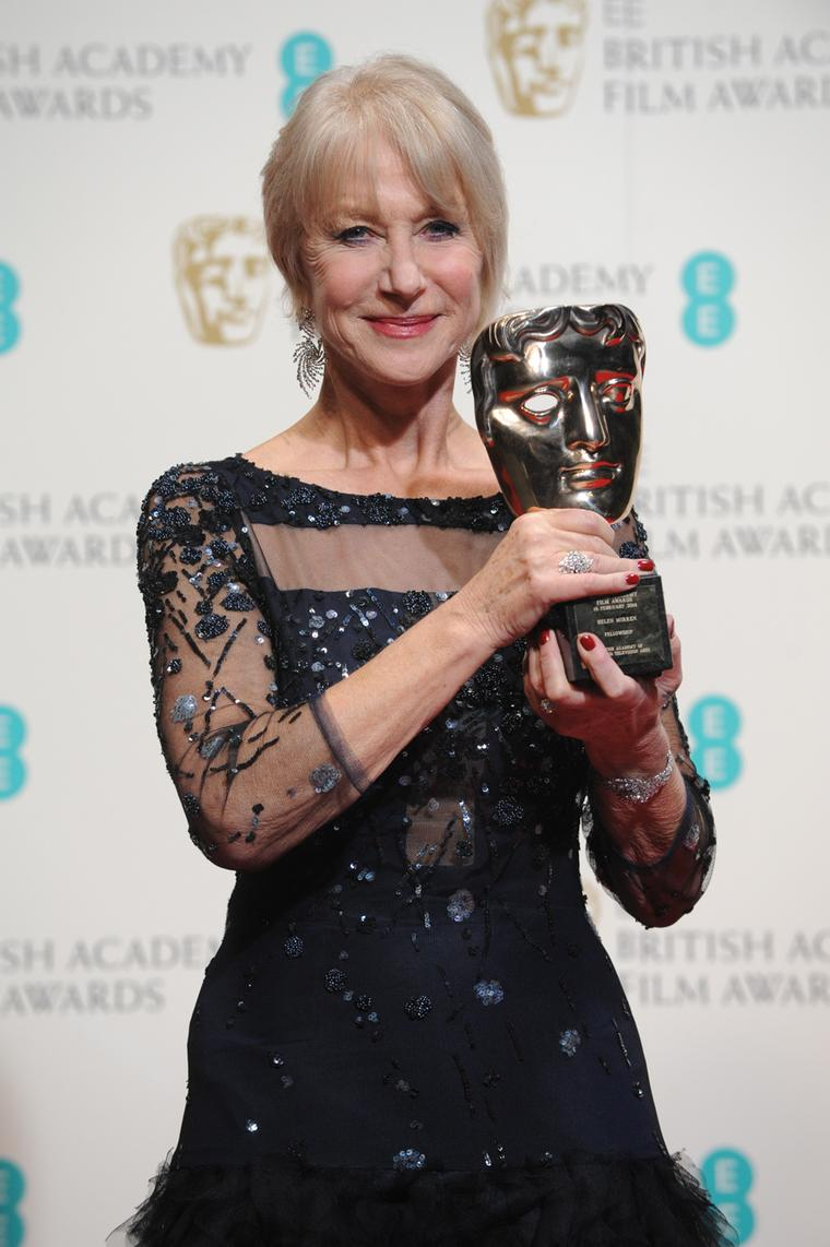 Helen Mirren collects her BAFTA Academy Fellowship Award wearing the earrings, ring and cuff from Asprey's new Storm suite of jewels