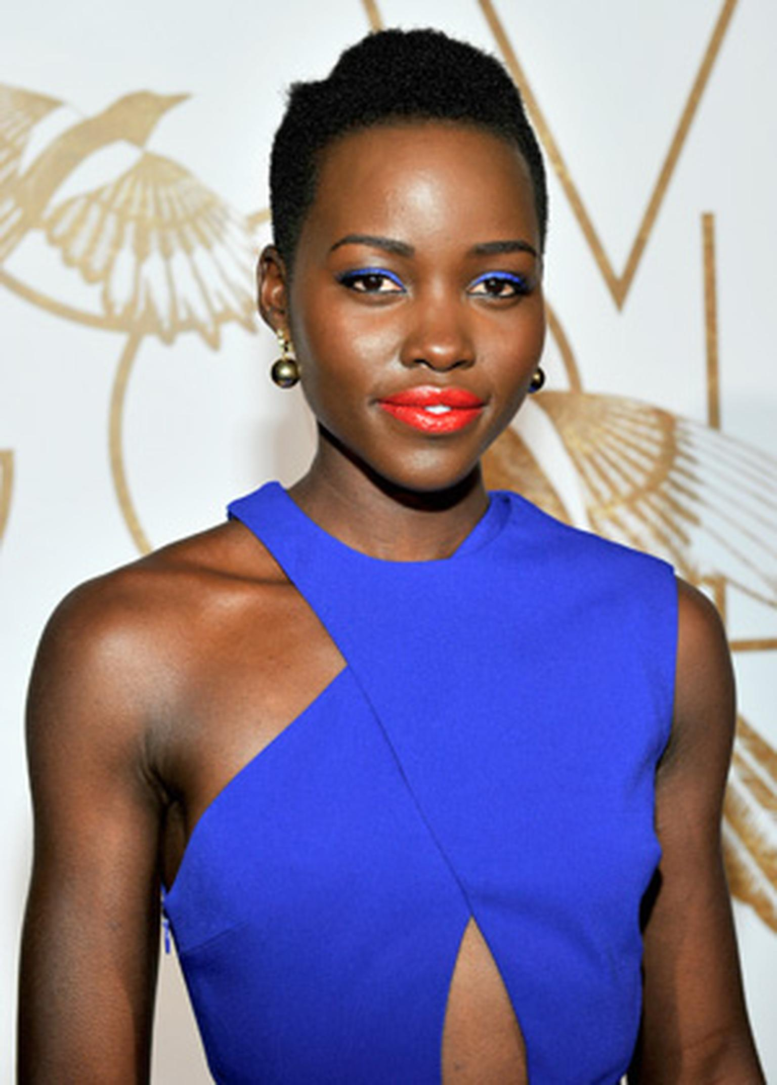 Lupita Nyong'o wore Elena Votsi gold and diamond earrings and a gold ring to a LoveGold event held in LA in her honour on 26 February 2014
