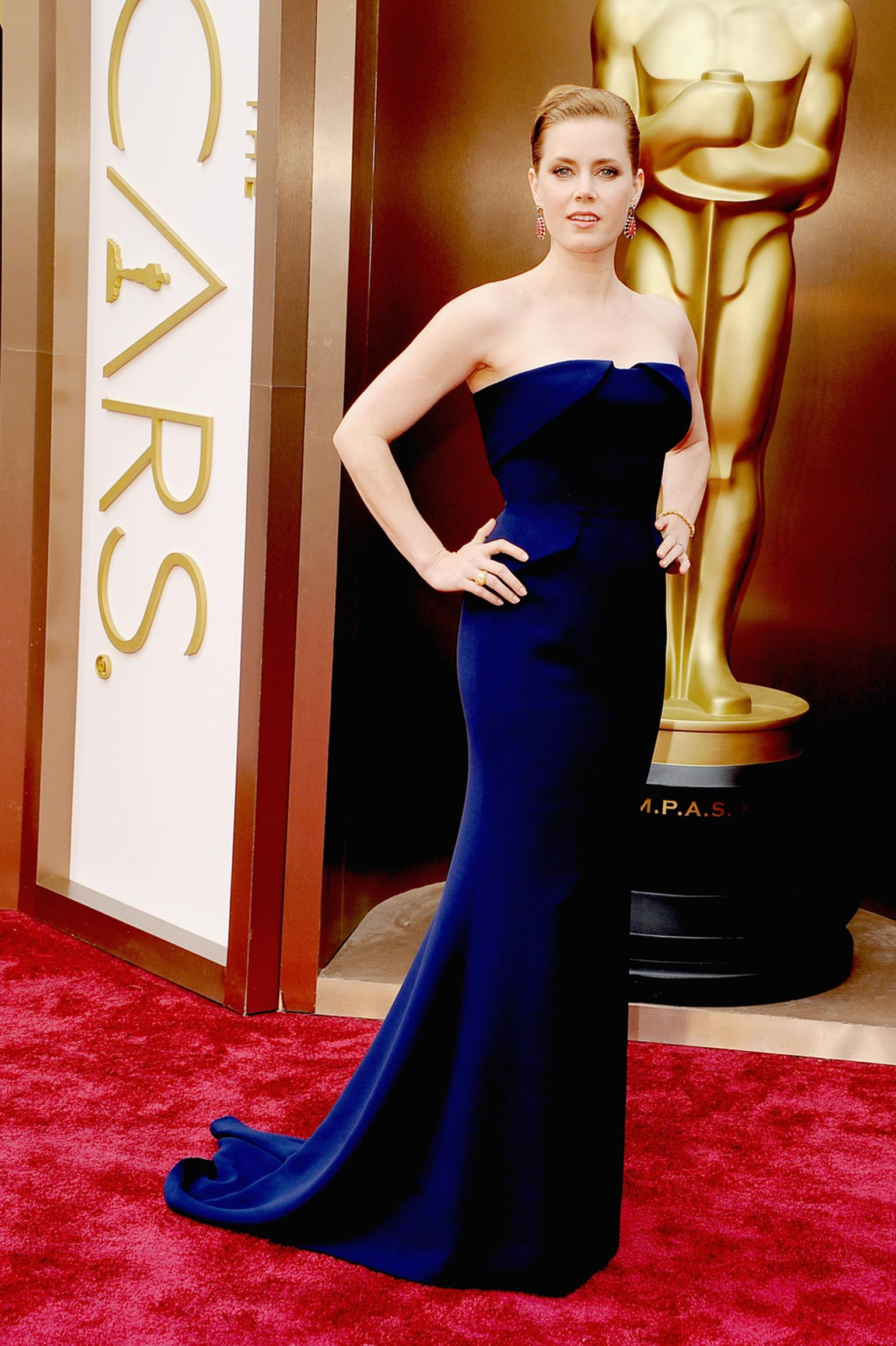 Amy Adams paired her classic navy gown with some of the most colourful jewels of the night, including a gold Tiffany fire opal ring with pink sapphires, yellow diamond and spessarite beads
