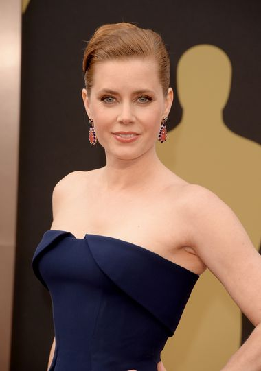 Nominated for Best Actress for her role in 'American Hustle', Amy Adams paired her deep blue Gucci gown with colourful Tiffany Blue Book Collection rodochrosite, lapis and turquoise gold earrings