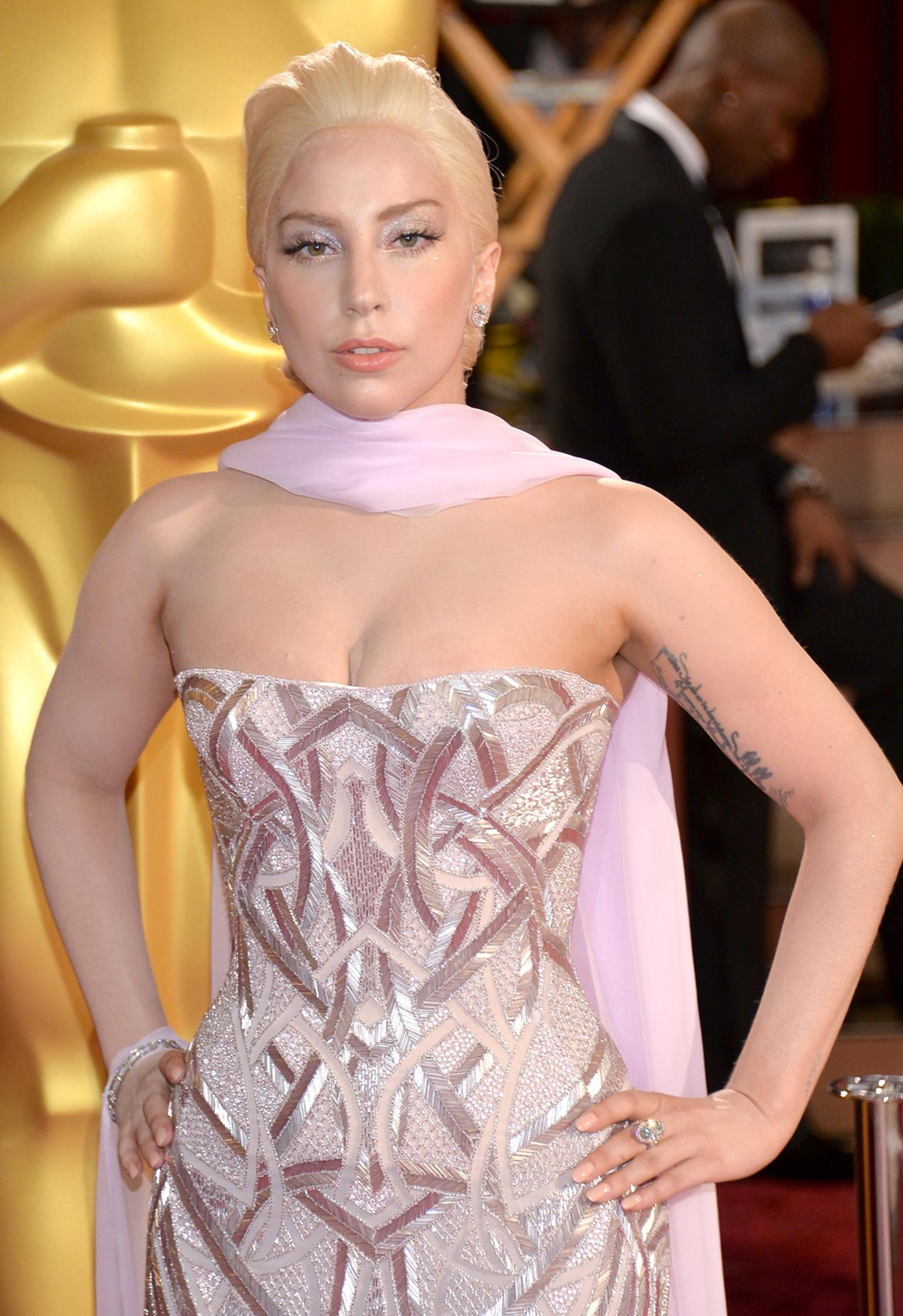 Lady Gaga wore a metallic-pink Versace gown with Lorraine Schwartz jewels