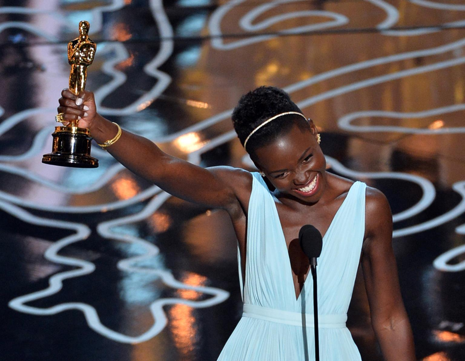 "Oscar winner Lupita Nyong'o also chose a delicate Fred Leighton 19th century gold and diamond snake bracelet, a trio of vintage rings and a gold Frog ring, which she described as her ""family totem"""