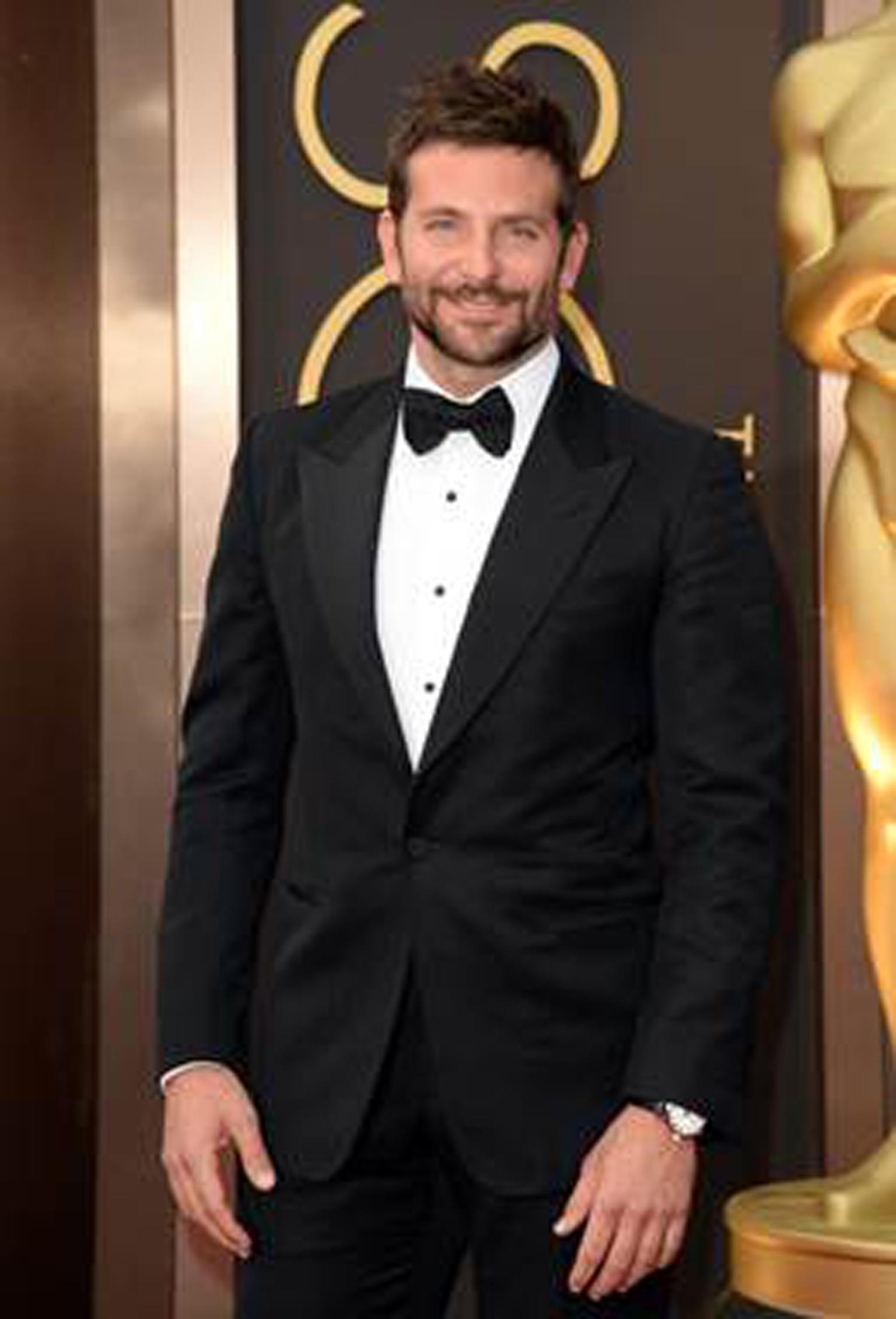 Nominated for Best Actor in a Supporting Role, Bradley Cooper selected Chopard's L.U.C 1937 stainless steel Classic timepiece featuring a white dial and black alligator strap.