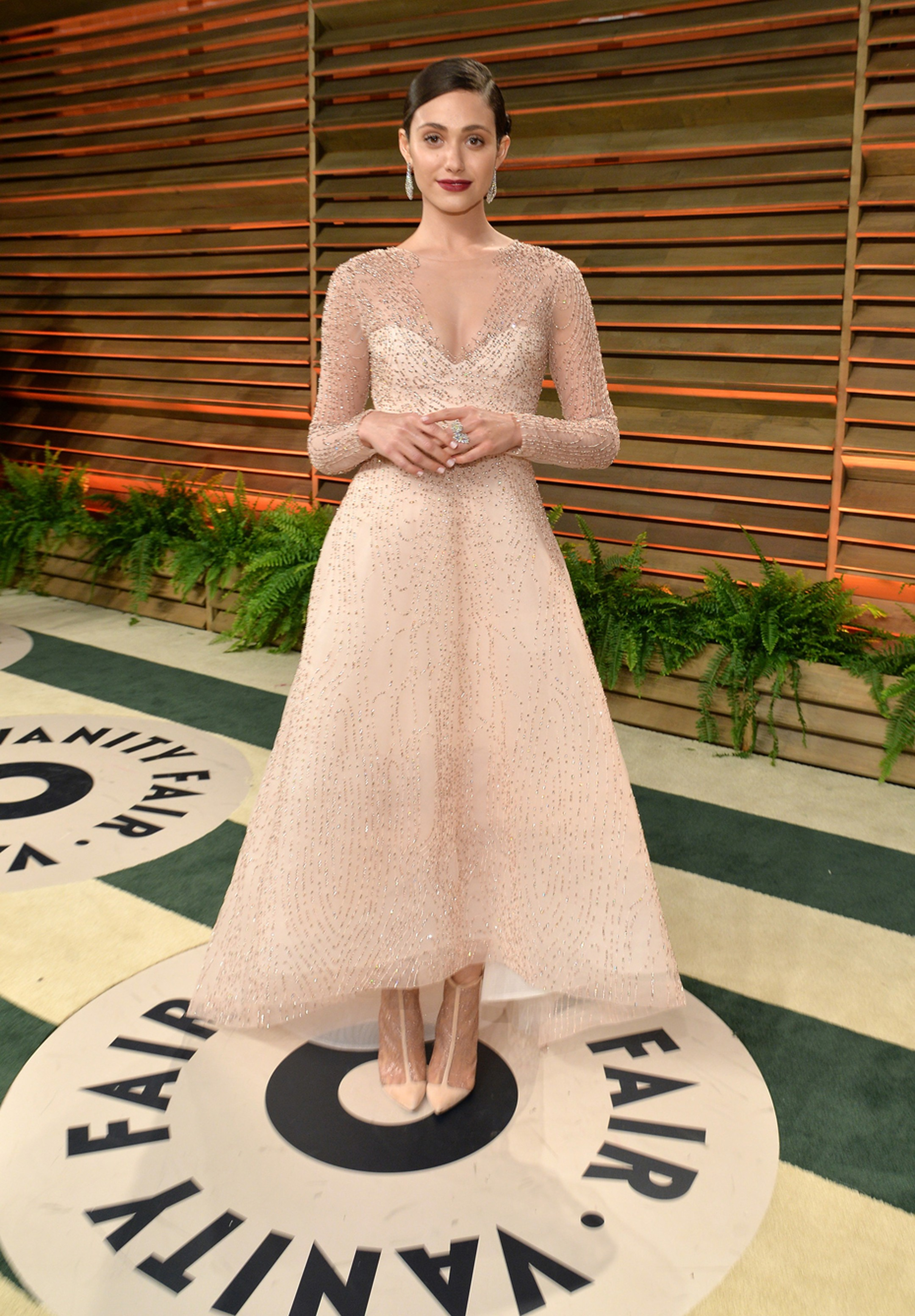 Emmy Rossum at the Vanity Fair after party wearing a shimmering Monique Lhuillier dress with Chopard jewels.