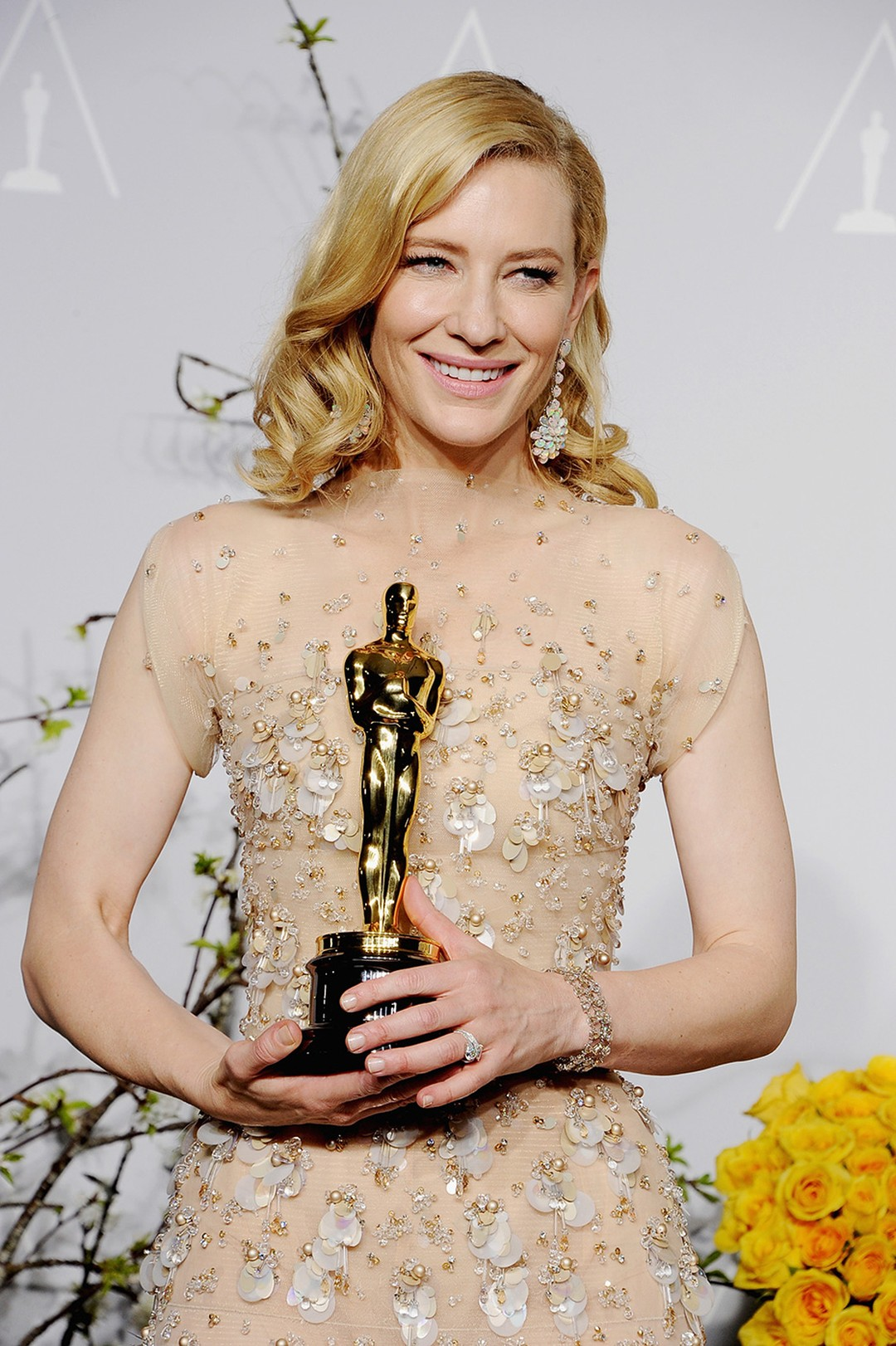 Cate Blanchett is all smiles with her Academy Award and Chopard Red Carpet Collection earrings.