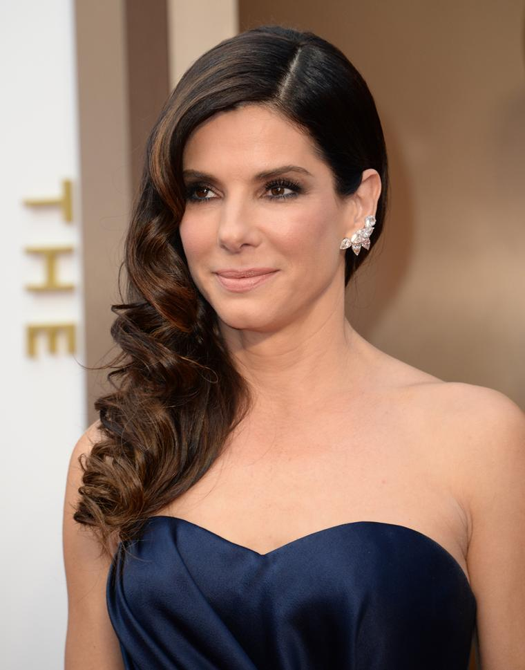 Sandra Bullock in Lorraine Schwartz platinum and diamond cluster earrings valued at US$1.8 million and a platinum and diamond bracelet