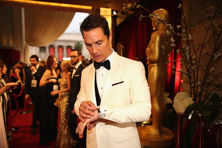 Matthew McConaughey checks the time on his white gold Chopard L.U.C XP Tonneau watch