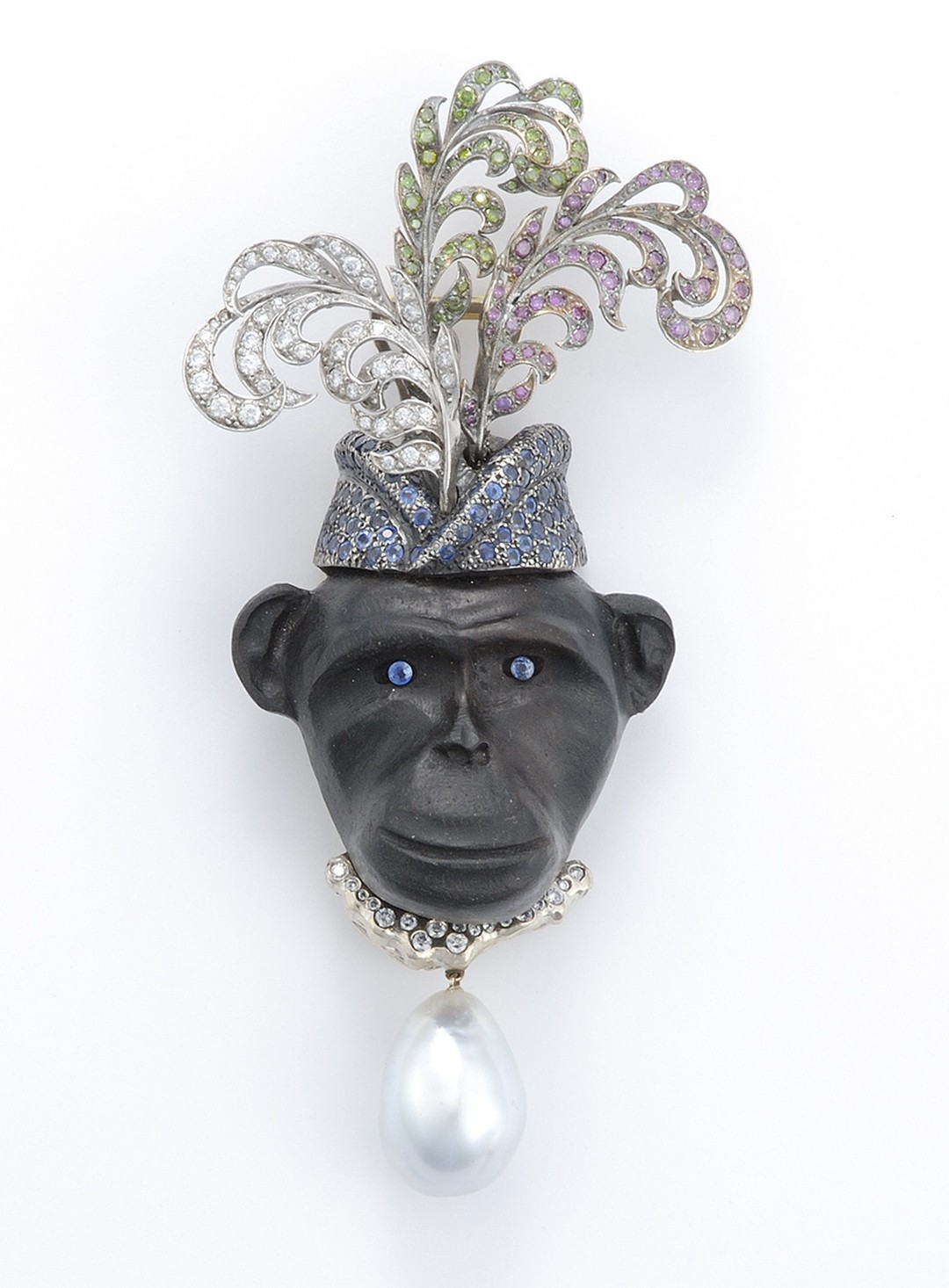 Sorab & Roshi Royal Monkey pin in ebony wood with pavé white, green and pink diamond feather hat and a sapphire and South Sea pearl drop