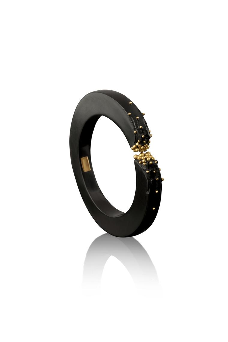 Limited-edition Jacqueline Cullen hand-carved Whitby Jet gold granulated bangle.
