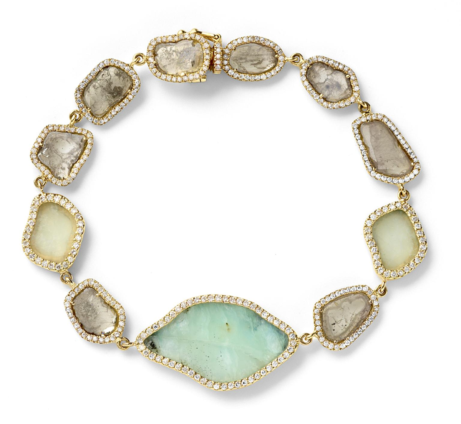 Monique Péan bracelet featuring cream fossilized woolly mammoth ivory, opal and serpentine surrounded by diamonds set in gold.